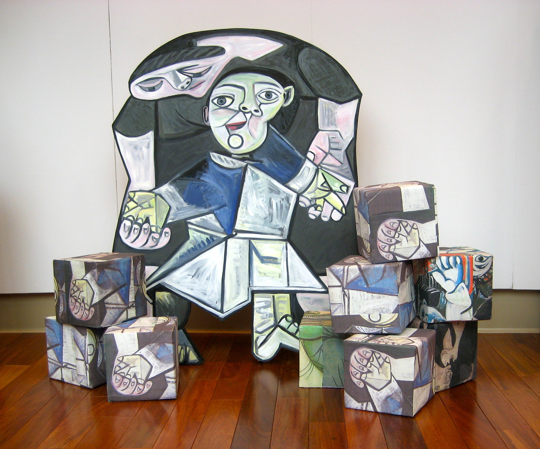 """AFTER PICASSO/CUBES R US"", Life size painted wood cutout/ painted boxes, $4000."