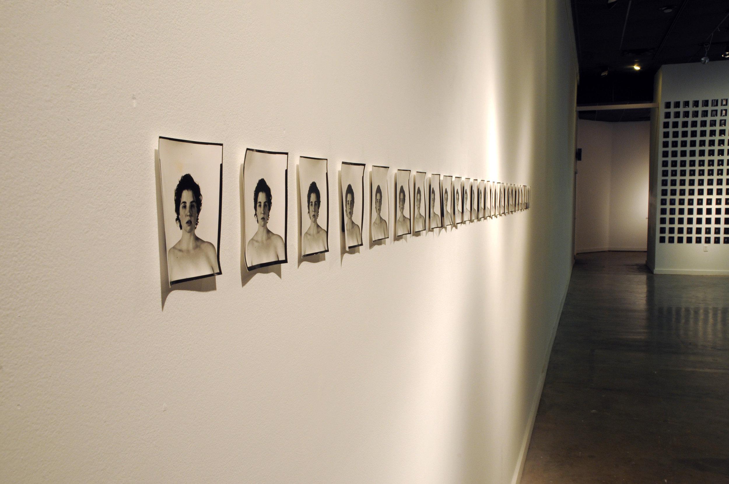 """""""Her"""". 2012. Silver Gelatin Photographs, Vinyl Lettering. 1423 sq.ft."""