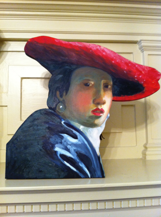 """AFTER VERMEER/ LADY IN A RED HAT"", life size painted wood cutout, 14"" x 13"", $2000.00"