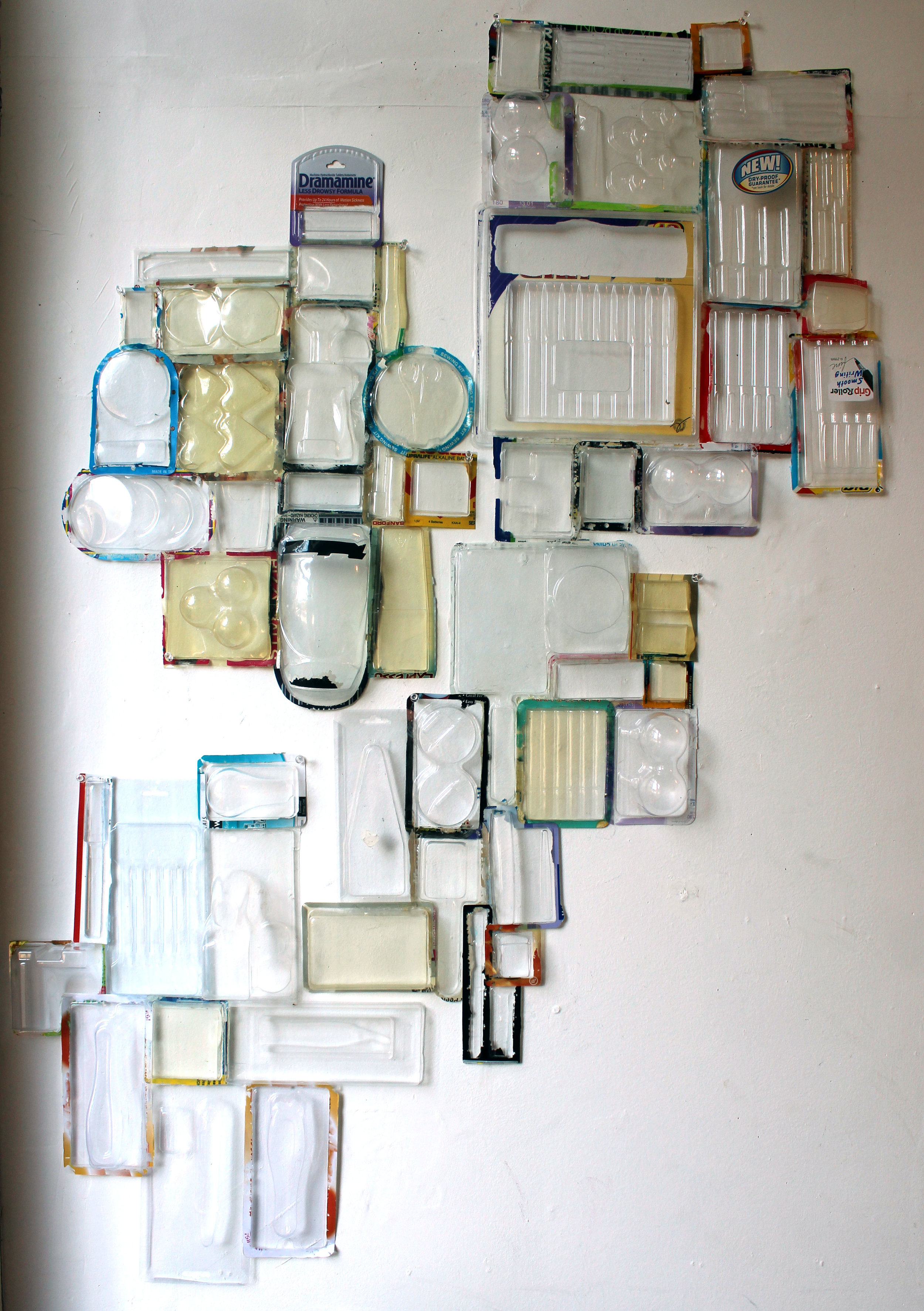 """""""Breaking Up Is Hard To Do""""  Plastic vacuum formed food packing assemblage, 4 groupings, 47""""x 30"""", each $450."""