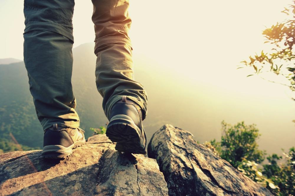 woman hiker stand on mountain peak.jpg