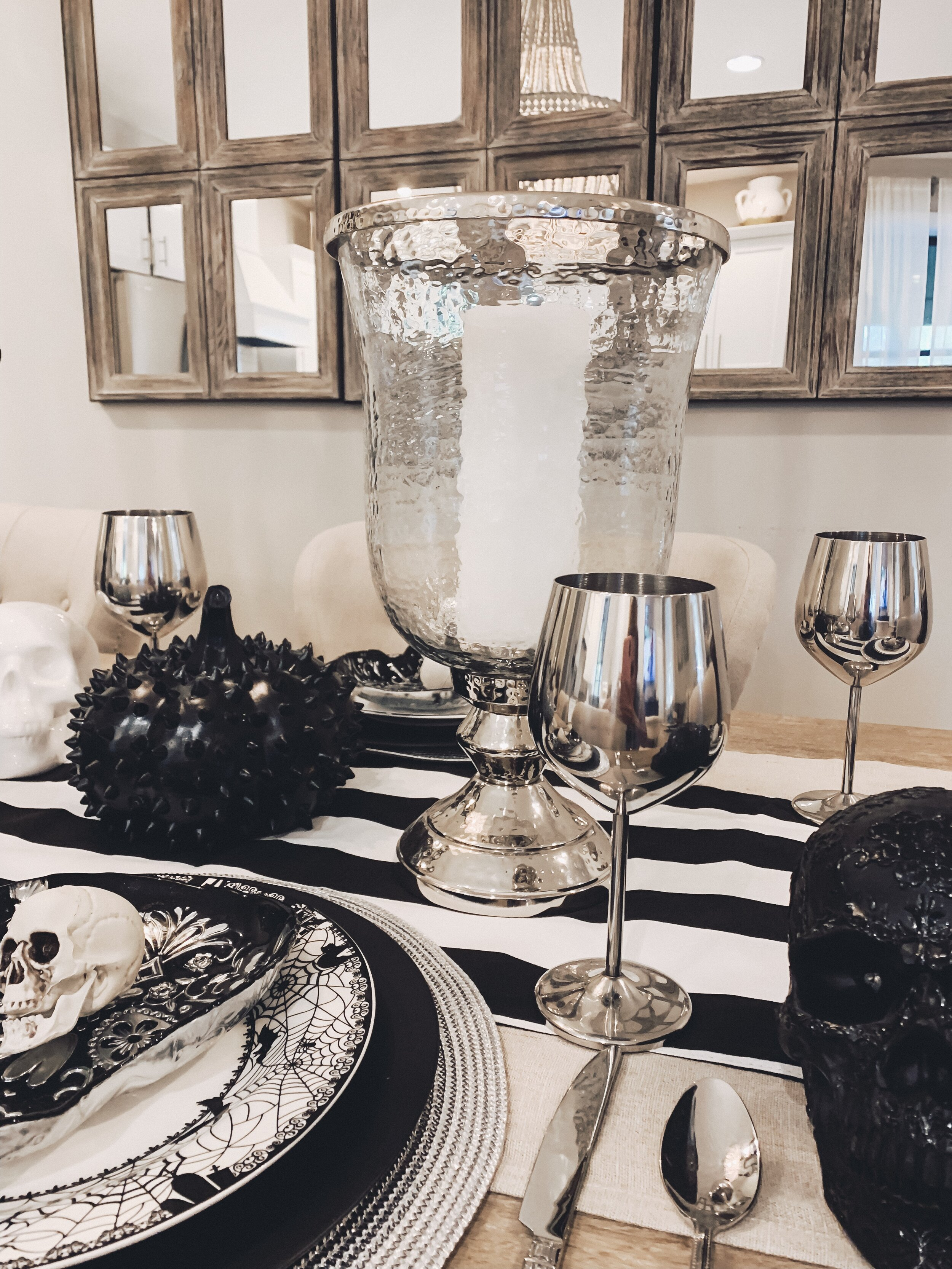 Candle holders and silver cups that always stay on my table