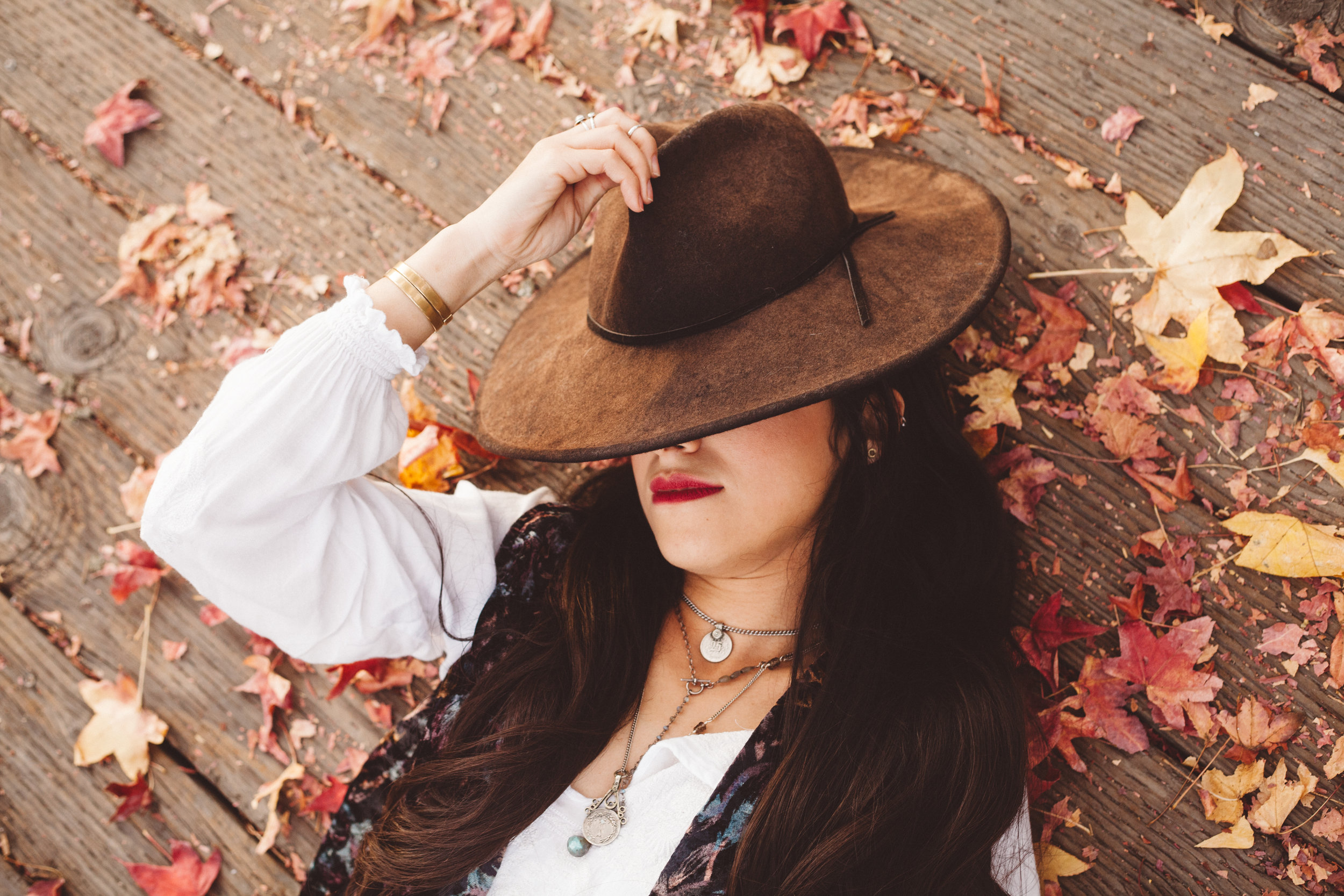 Vintage coin necklaces paired with Labradorite lariat necklace. Photo by Ruby Villalobos.
