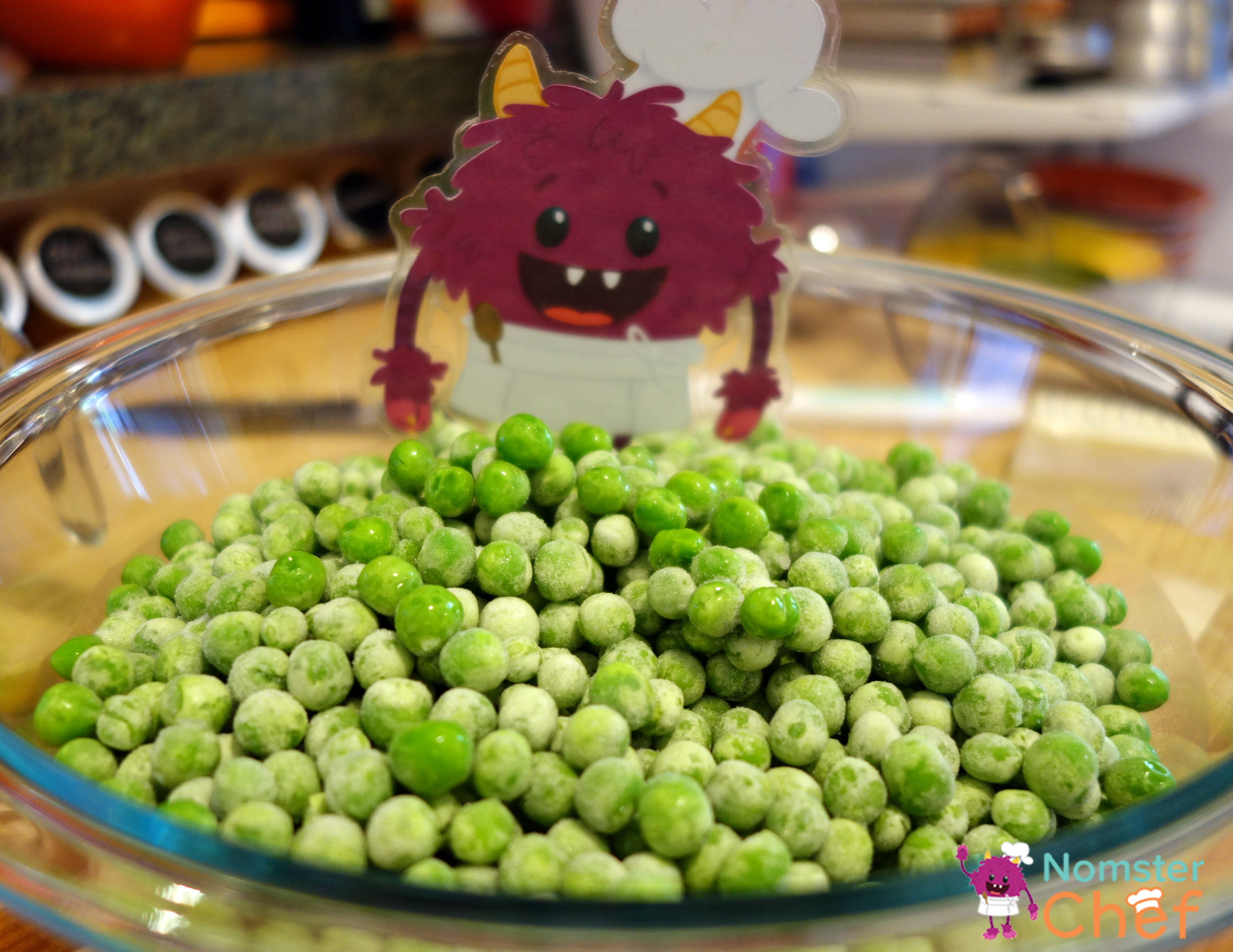 Nomster in bowl of peas- minty gazpacho soup-Nomster Chef