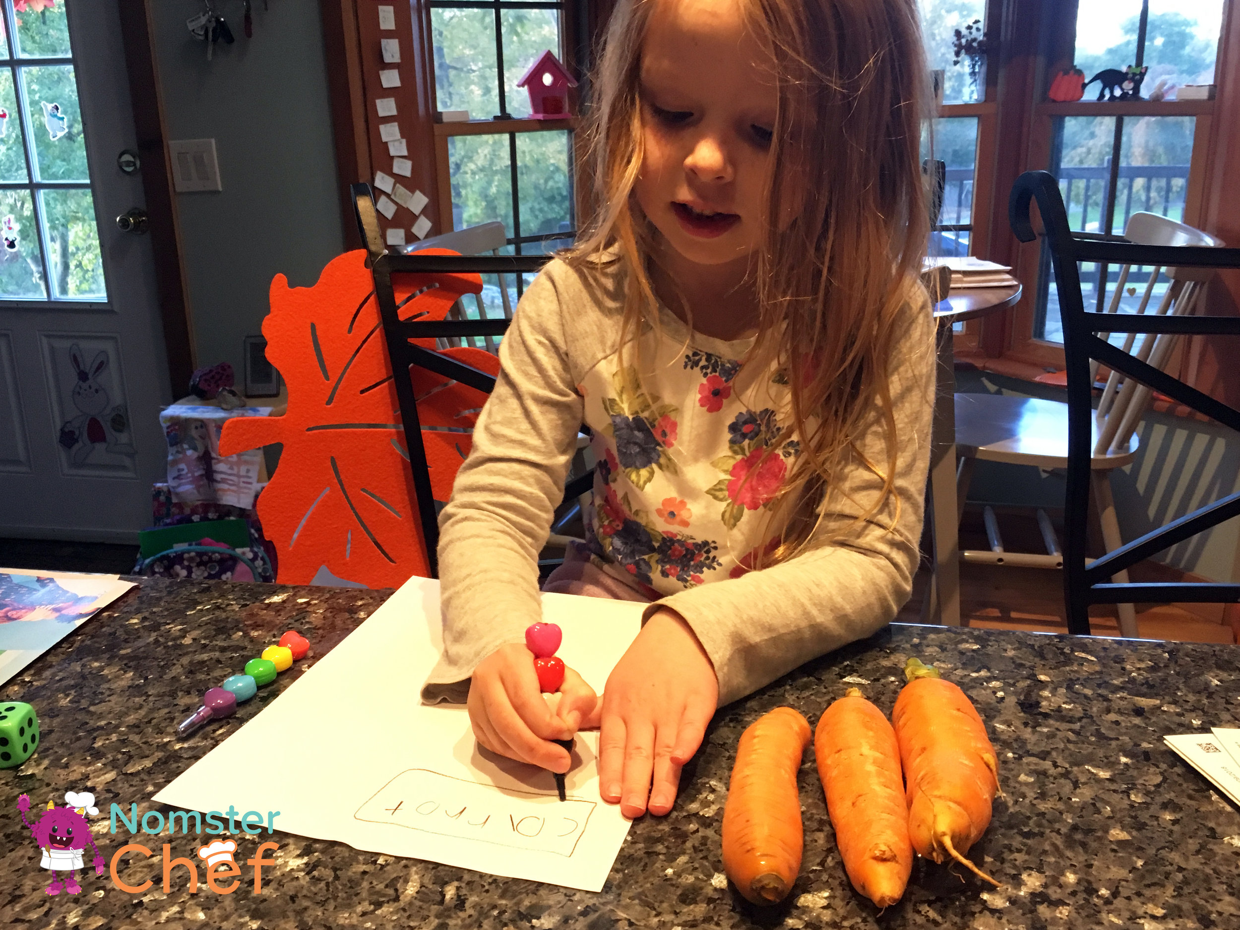 Emma writes her ideas for carrot dishes