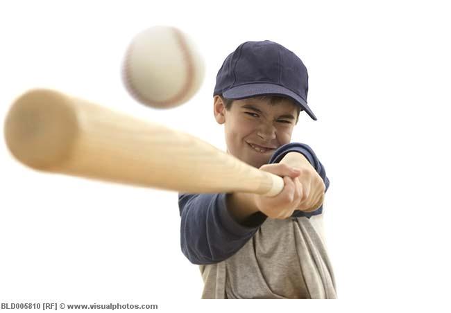 boy_swinging_baseball_bat_at_ball_bld005810.jpg