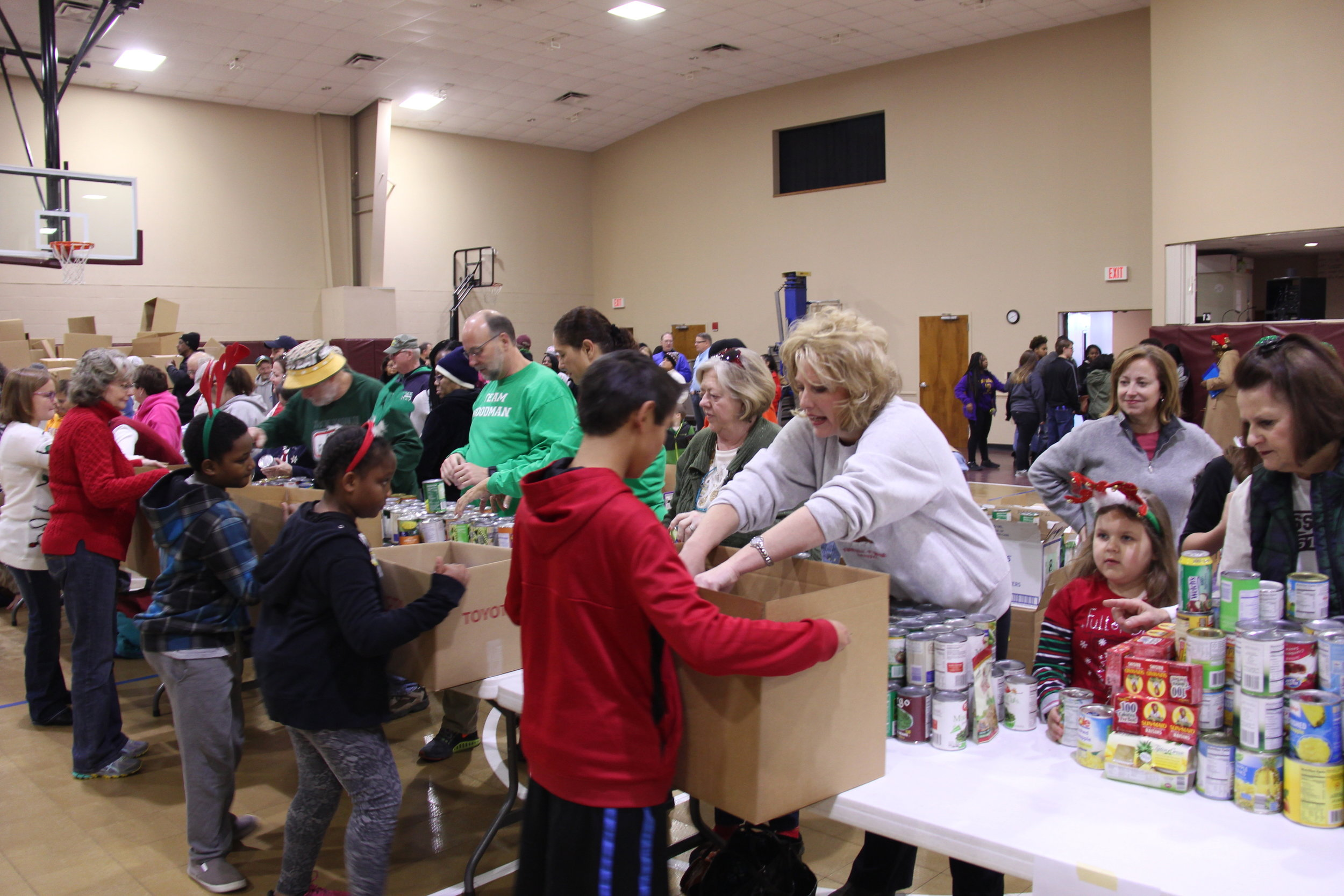 From left are Fayette Cares volunteers Jennifer and Casey Clayton sorting thousands of toys to be distributed to disadvantaged children.