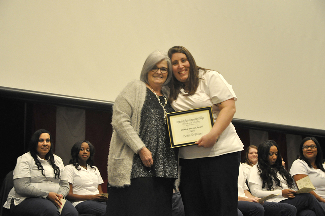 DSCC Nursing Instructor Anne Gregory (left) presented the Clinical Practice Award to traditional nursing class graduate Donielle Dennis (right) of Drummonds during DSCC's Nursing Pinning Ceremony Dec. 9.