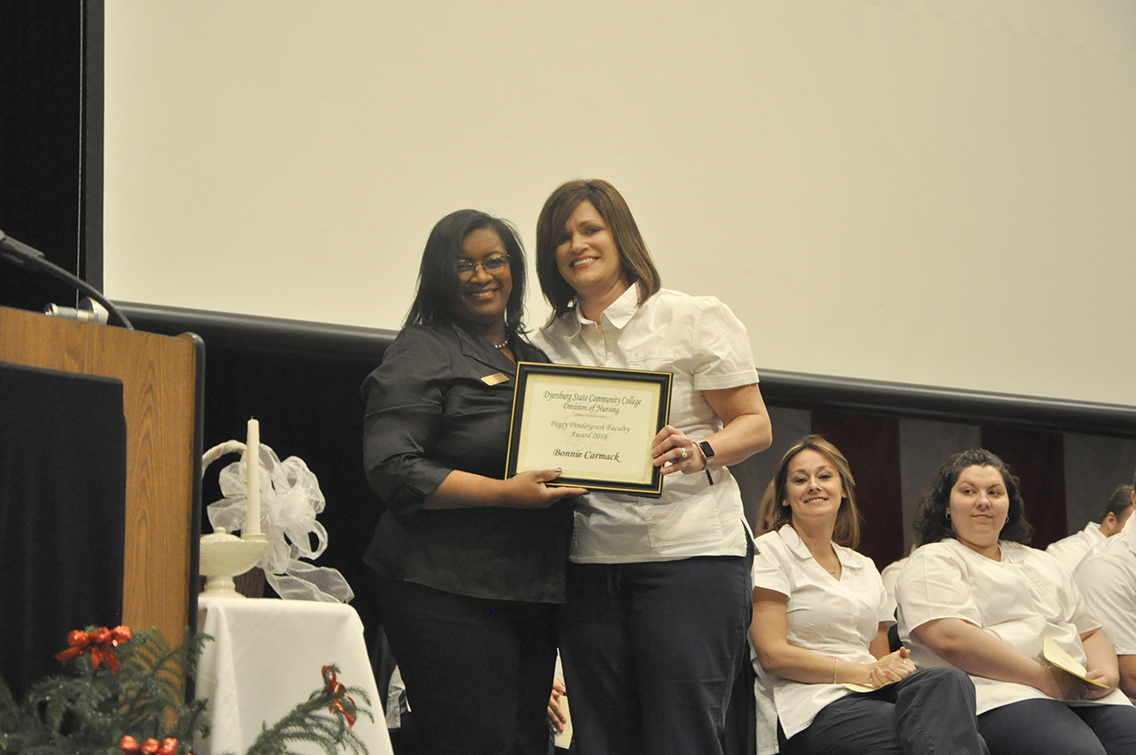 DSCC Nursing Instructor Trenna Richardson (left) presented the Peggy Pendergrast Faculty Award to nursing graduate Bonnie Carmack (right) of Gates.