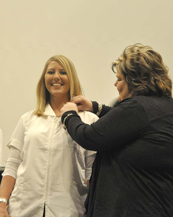Nursing graduate Bailey Browning (left) of Covington received her nursing pin from Dean of Nursing Amy Johnson (right) during DSCC's Nursing Pinning Ceremony Dec. 9.