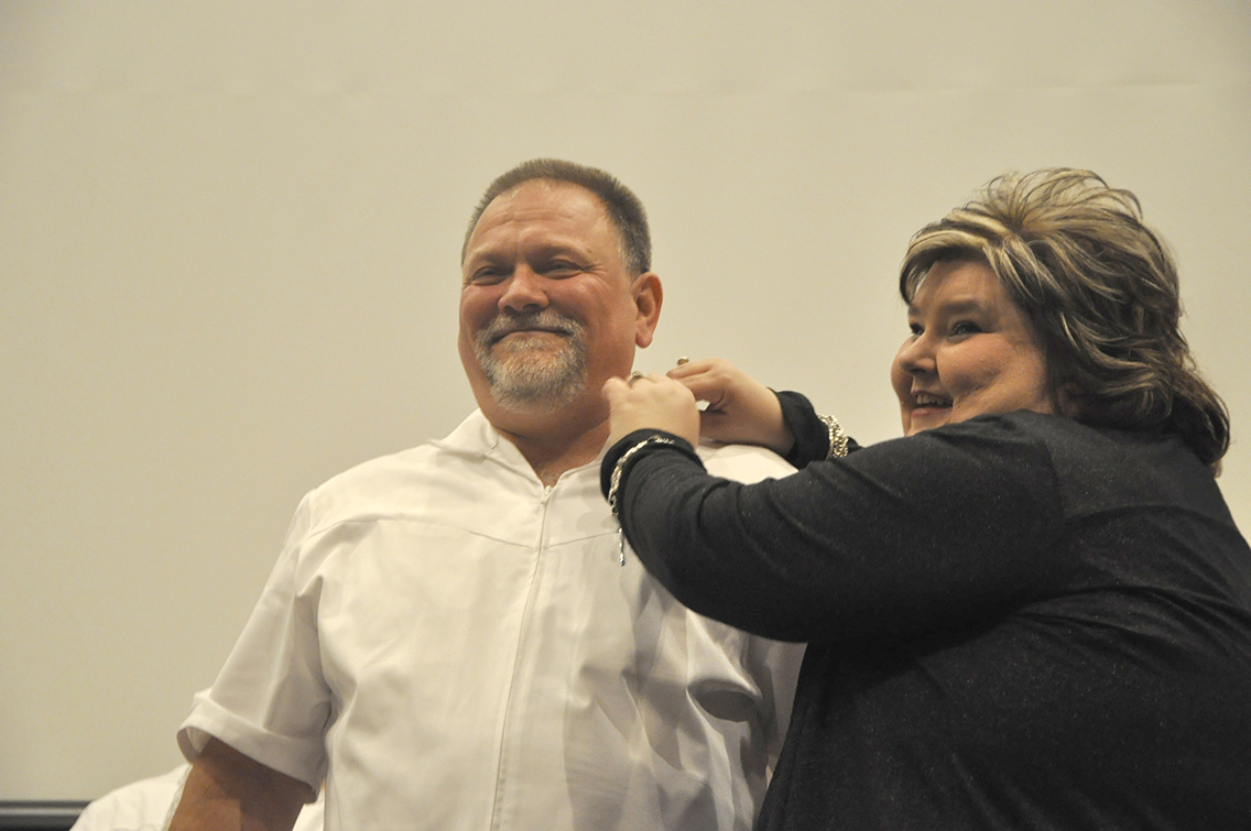 Richard Keenan (left) of Drummonds received his nursing pin from Dean of Nursing Amy Johnson (right) during DSCC's Nursing Pinning Ceremony Dec. 9.