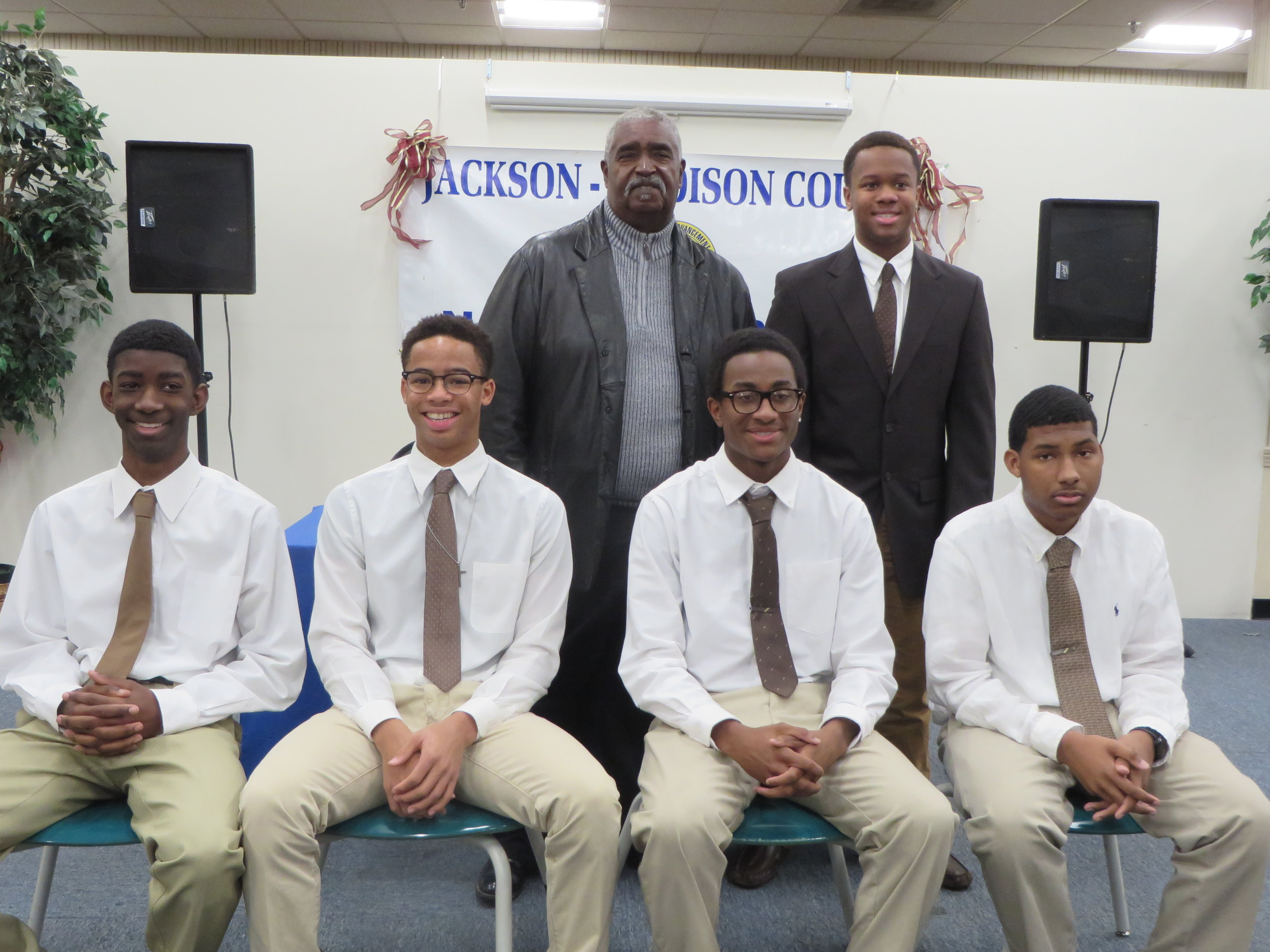 Left to right standing: James Neely, parent and former Kudos Sean Utley  Left to right seated: Kudos Malcolm Arnold, Jonathan Utley, George Berniard, and Jabin Coleman