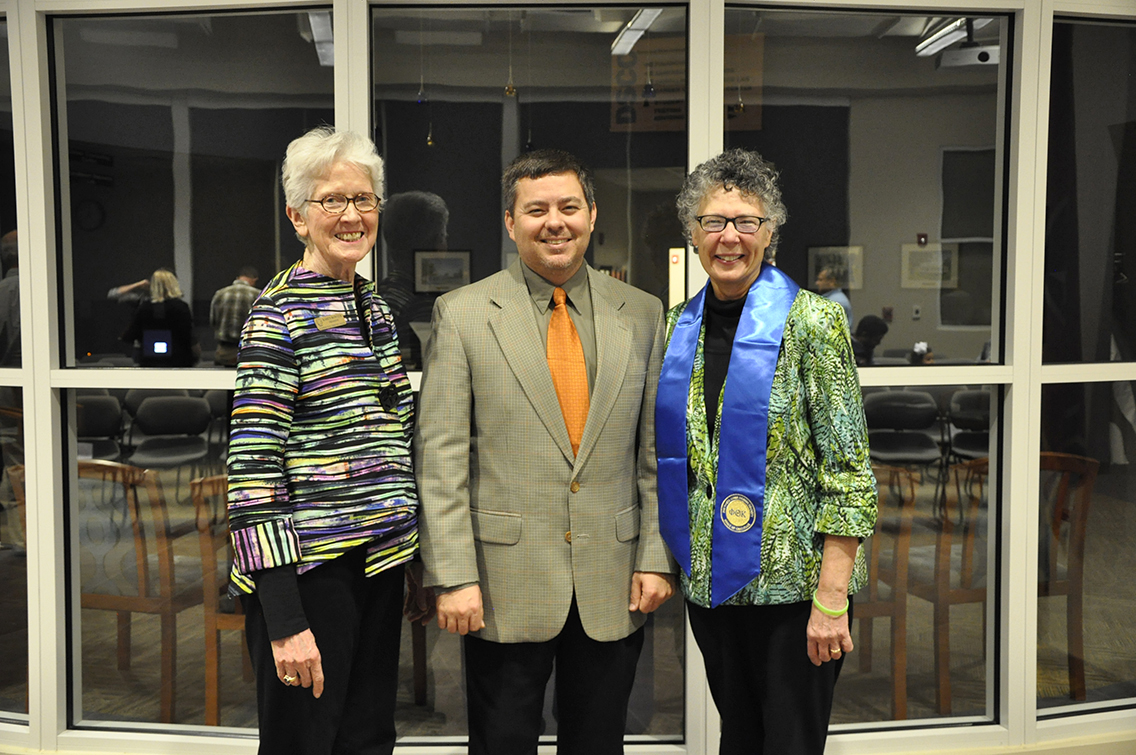 Dr. Karen Bowyer, president of DSCC, Dr. Brigham Scallion, instructor of Biology at DSCC and PTK Chapter Advisor, and Dr. Teri Maddox, vice president for the College, pose for a photo during DSCC's 2017 Induction Ceremony March 17. Maddox was presented with a stole of gratitude from the PTK leadership team for her unwavering support to PTK over the past few years.