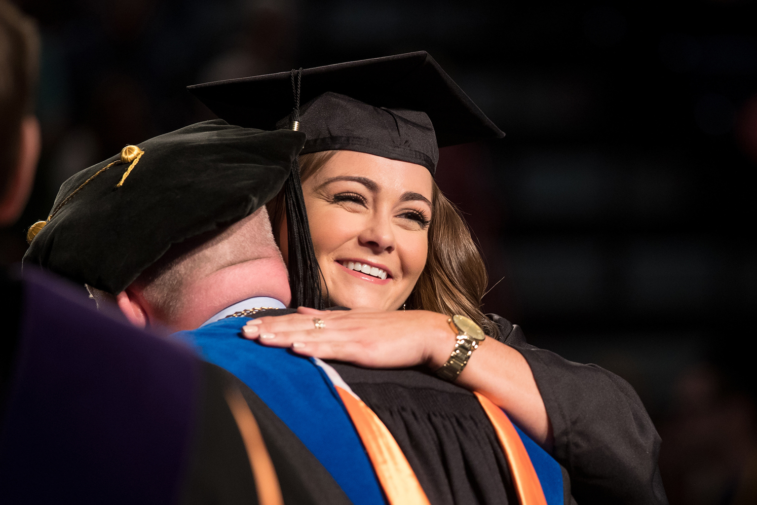 Hannah Robison, of Springville, hugs UT Martin Chancellor Keith Carver as she  crosses the commencement stage May 7.