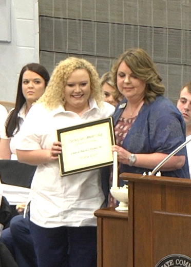 Nursing graduate Hollie Goff (left) of Dyersburg was presented the Clinical Practice Award by nursing instructor Tammy Hines (right) during DSCC's nursing pinning ceremony May 6.