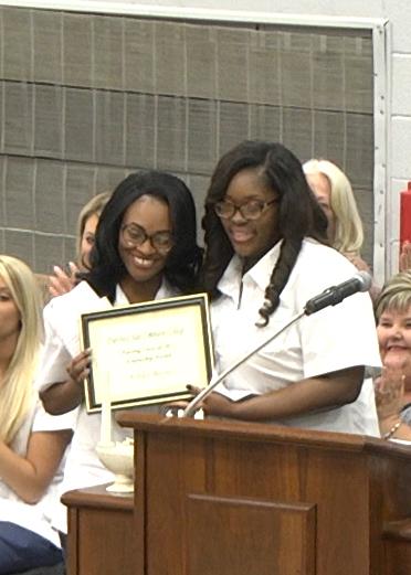 Nursing graduate Raven Warren (right) of Dyersburg presented the Friendship Award to fellow classmate Ashley Barnes (left) of Henning during DSCC's nursing pinning ceremony May 6.