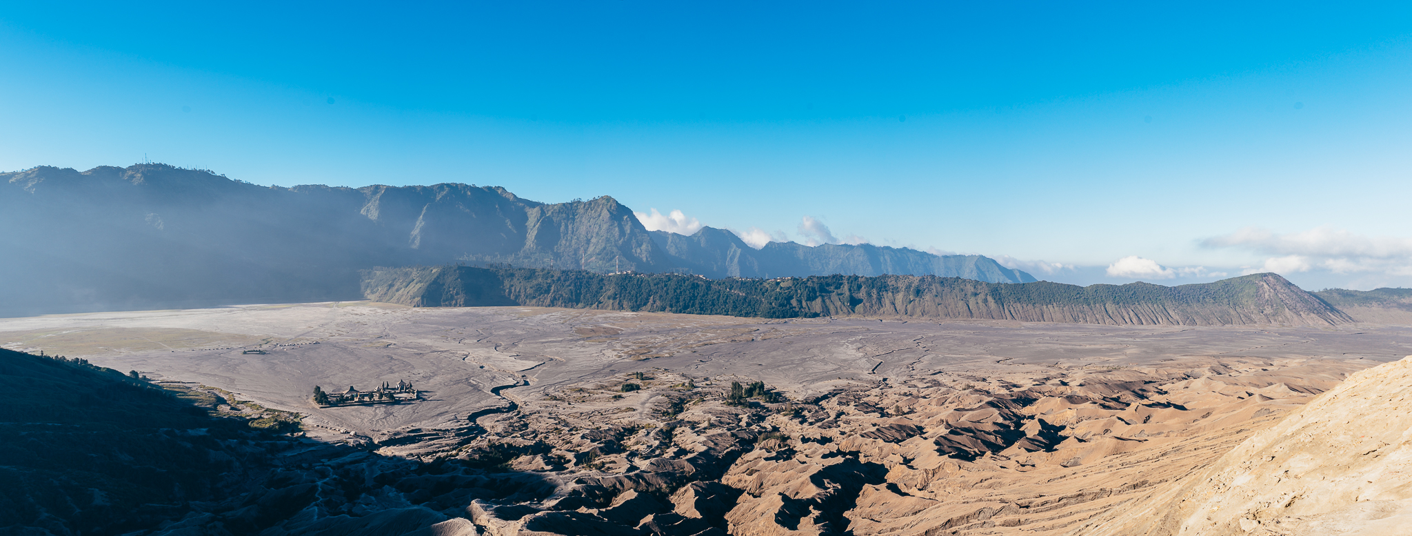 Perspective from the top of Bromo. You can see the Hindu temple on the left side of the photo.