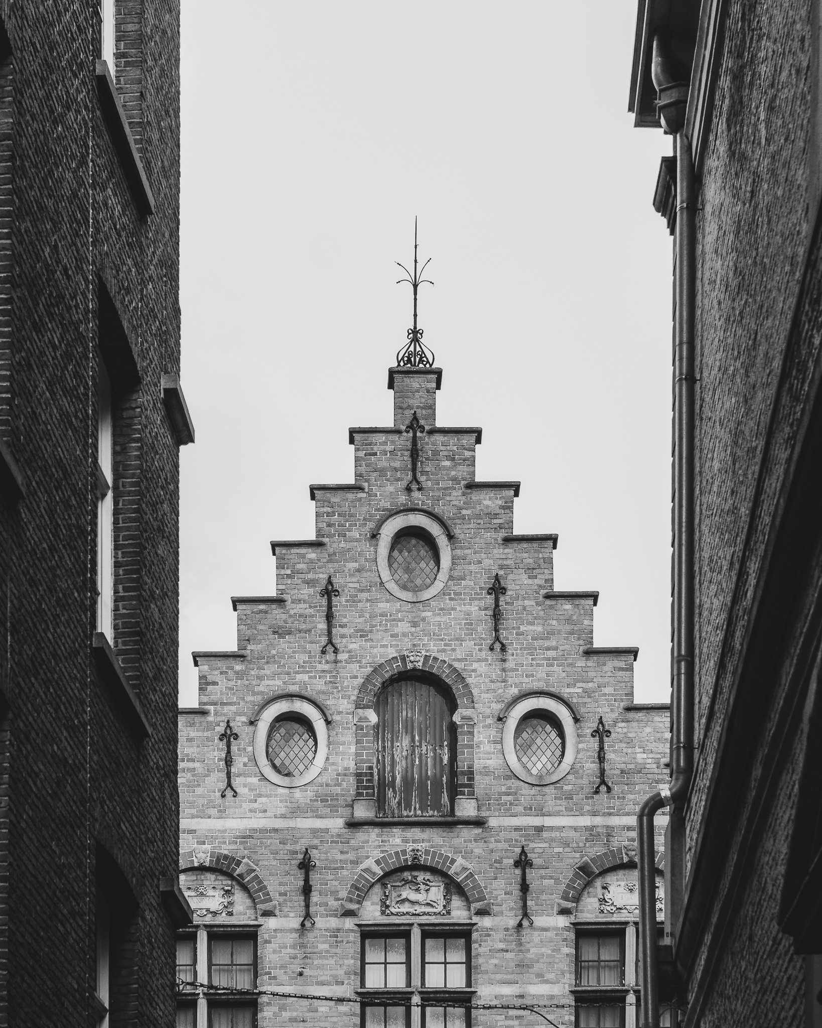The classic rooftops that make up Bruges iconic architecture... also made creepy by black and white.