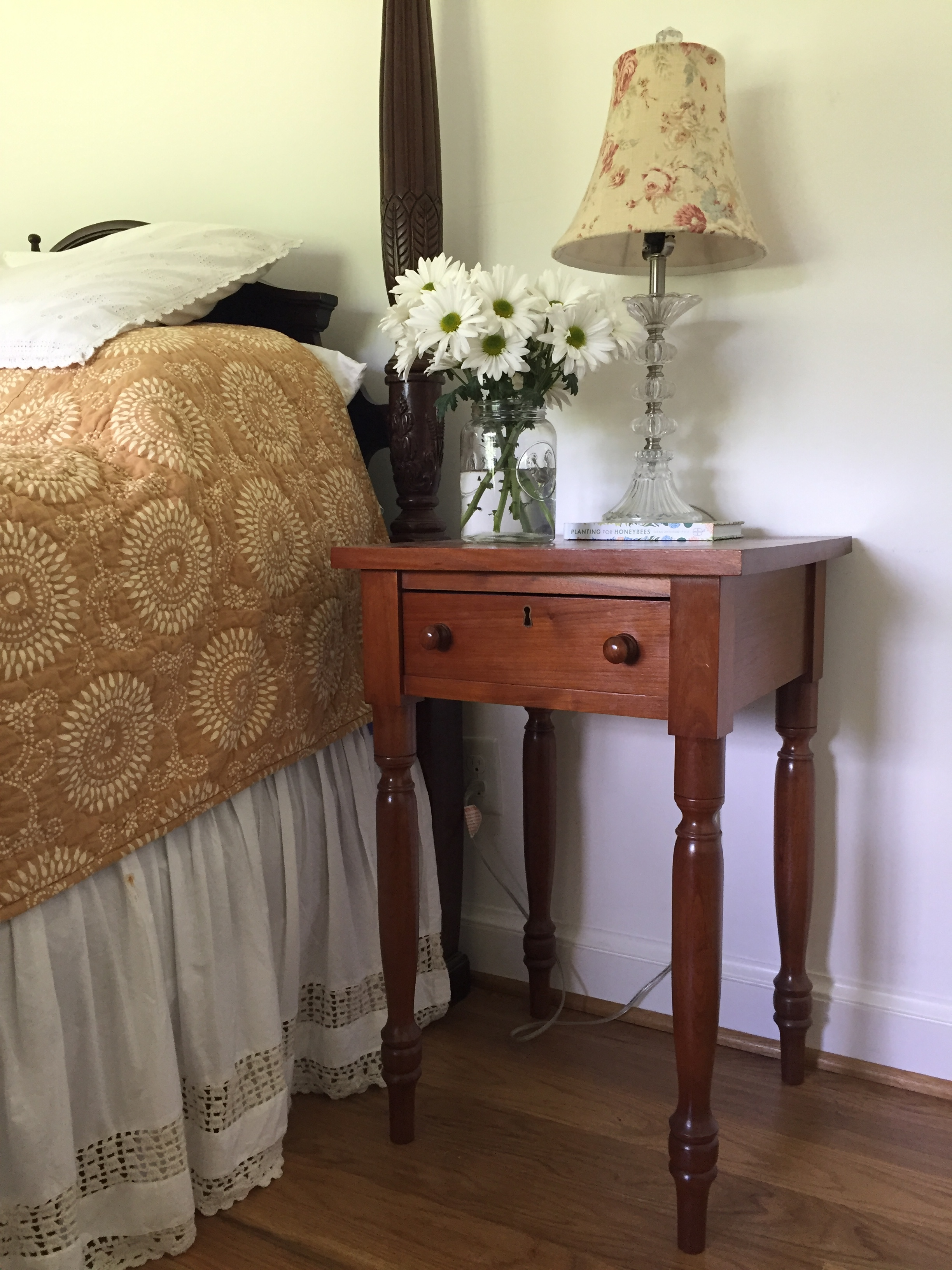 Both the bedside table and glass lamp are antiques I had collected over the years.