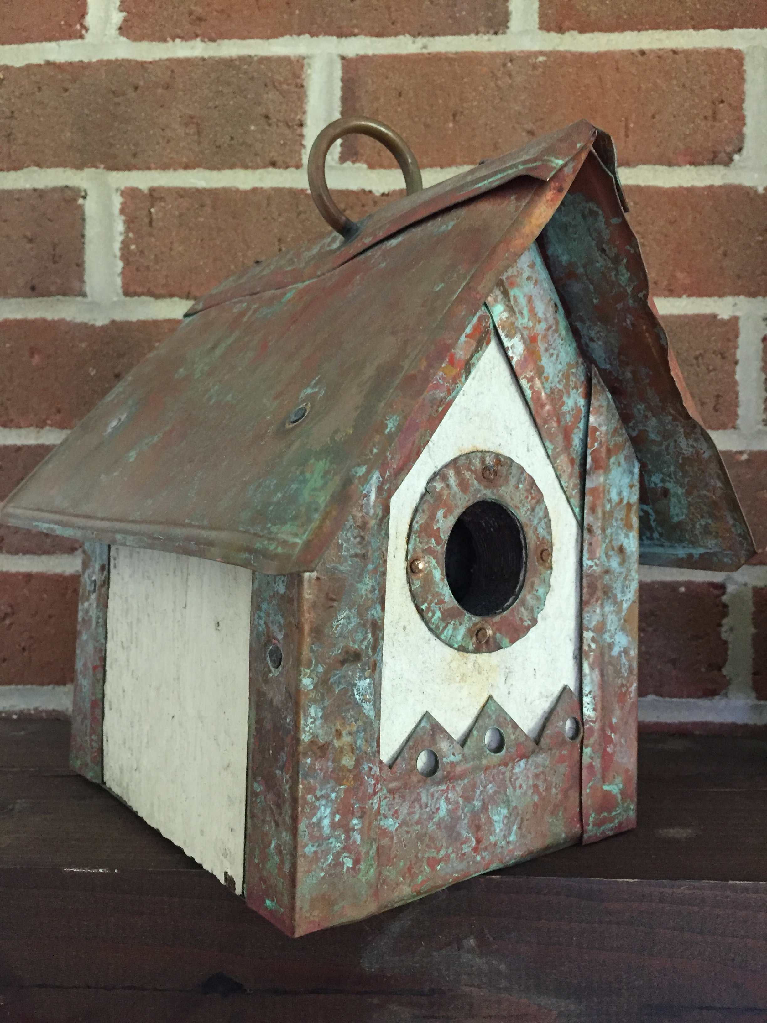 One of my brothers gave me this birdhouse years ago. It is made from salvaged copper and wood. It used to live in the recreation room of our previous house, but has found a much more agreeable home on the mantle of the bedroom fireplace.