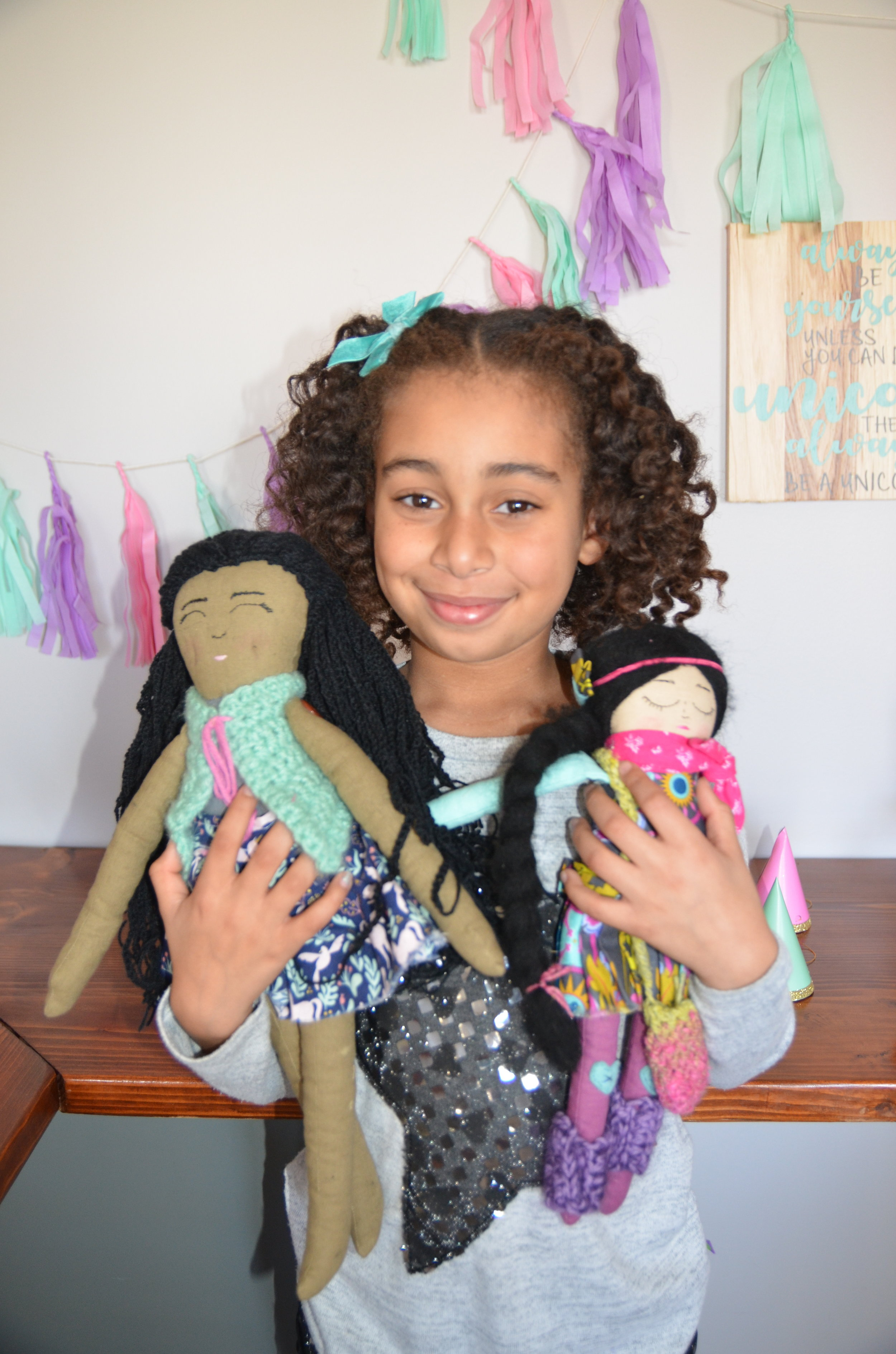 """I had planned in advance the gifts I wanted to get her for her birthday and I could think of nothing better than some handmade dolls. These ones are made from the incredible  Strange Folks Dolls.  I was utterly blown away by the results. I had sent her some pictures of Makkedah and told her a bit about her personality- her joyful spirit, her kind heart, and asked that she create a doll to look like her. The doll on the left is what she came up with. And the doll on the right is her precious friend that got to join in on the fun. Kristin makes her dolls with """"coffee stained linen/cotton, beautiful vintage buttons, wool stuffing, crocheted clothing, and simple embroidery in a """"sketched"""" style."""" When the package arrived in the mail, I kid you not, I cried. I was so touched with the love and care she put into creating these dolls for my daughter. Every little details absolutely floored me. I could not wait to give these dolls to Makkedah- more on that later."""