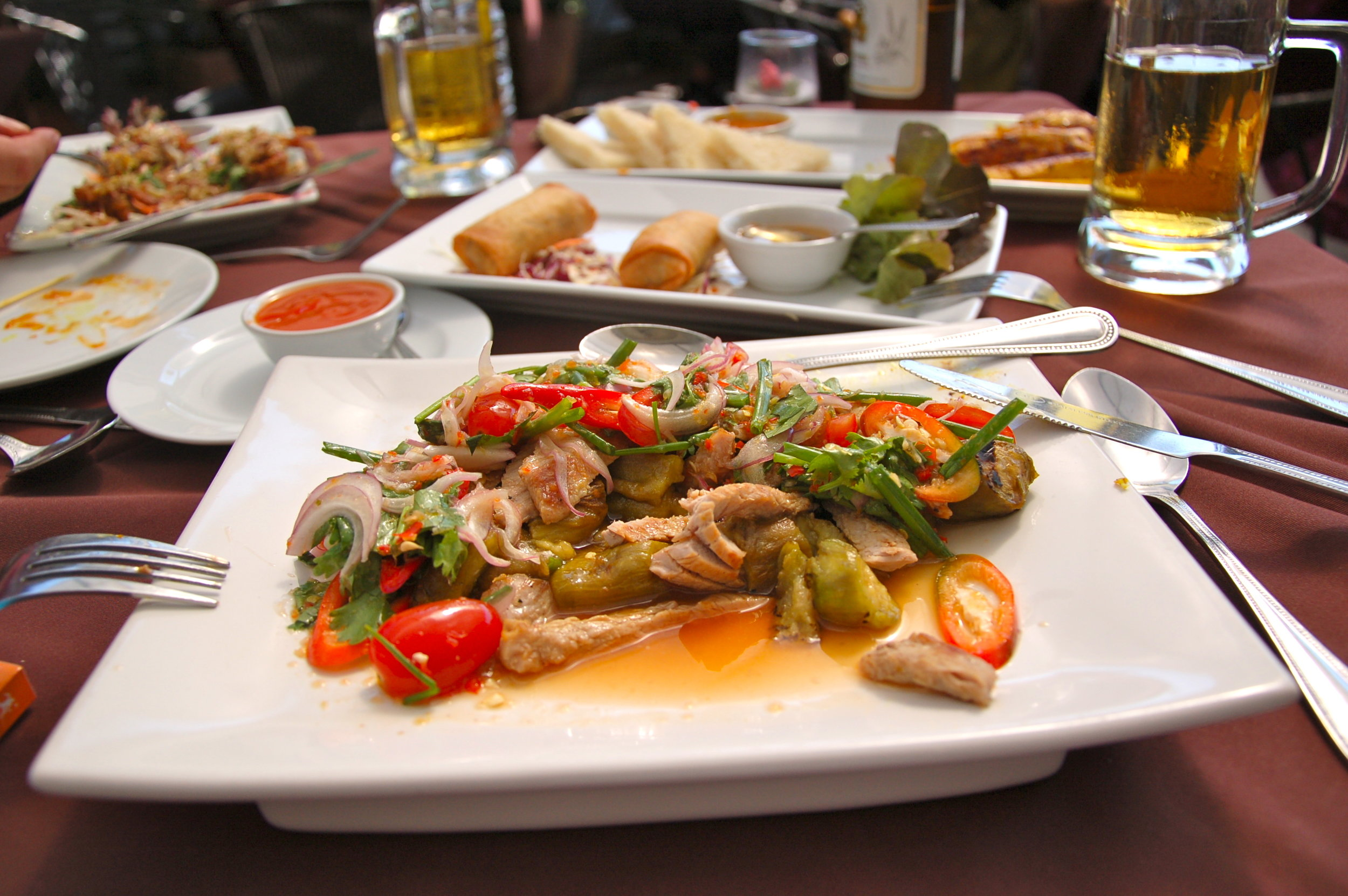 Next-level spicy chicken goes down better with a frosty Singha beer at The Deck at Arun Residence.