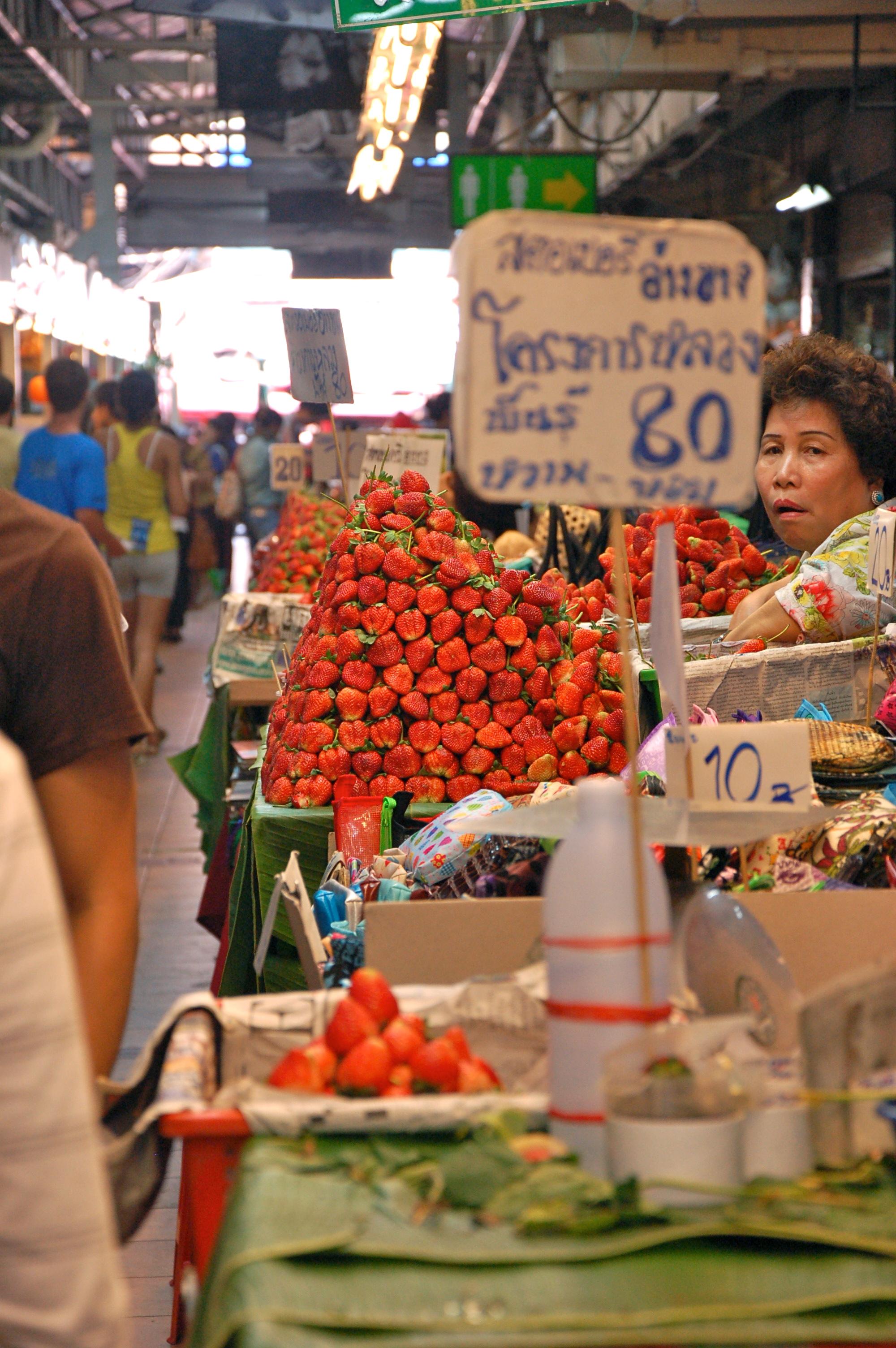 I'll take a dozen strawberries, please! (At Warowot Market)