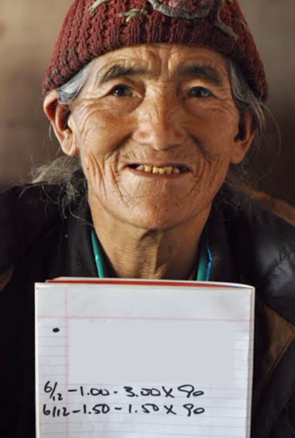 A woman in Nepal with her glasses prescription, which ReSpectacle was able to match and provide. Used with permission.