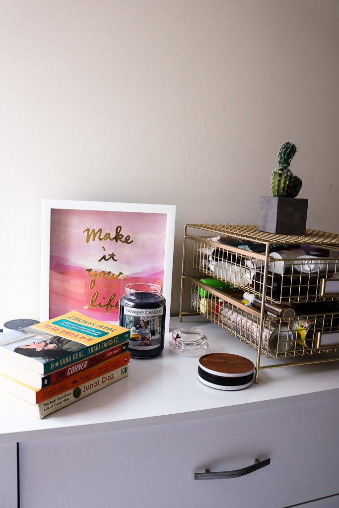 """The dresser nook where I keep what I'm """"currently reading"""" and daily beauty products."""