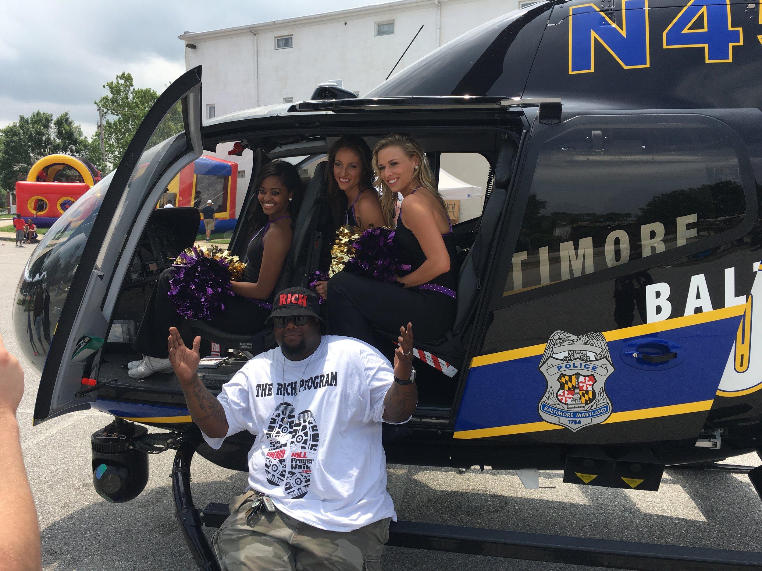Michael Battle Jr and Baltimore Raven cheerleaders