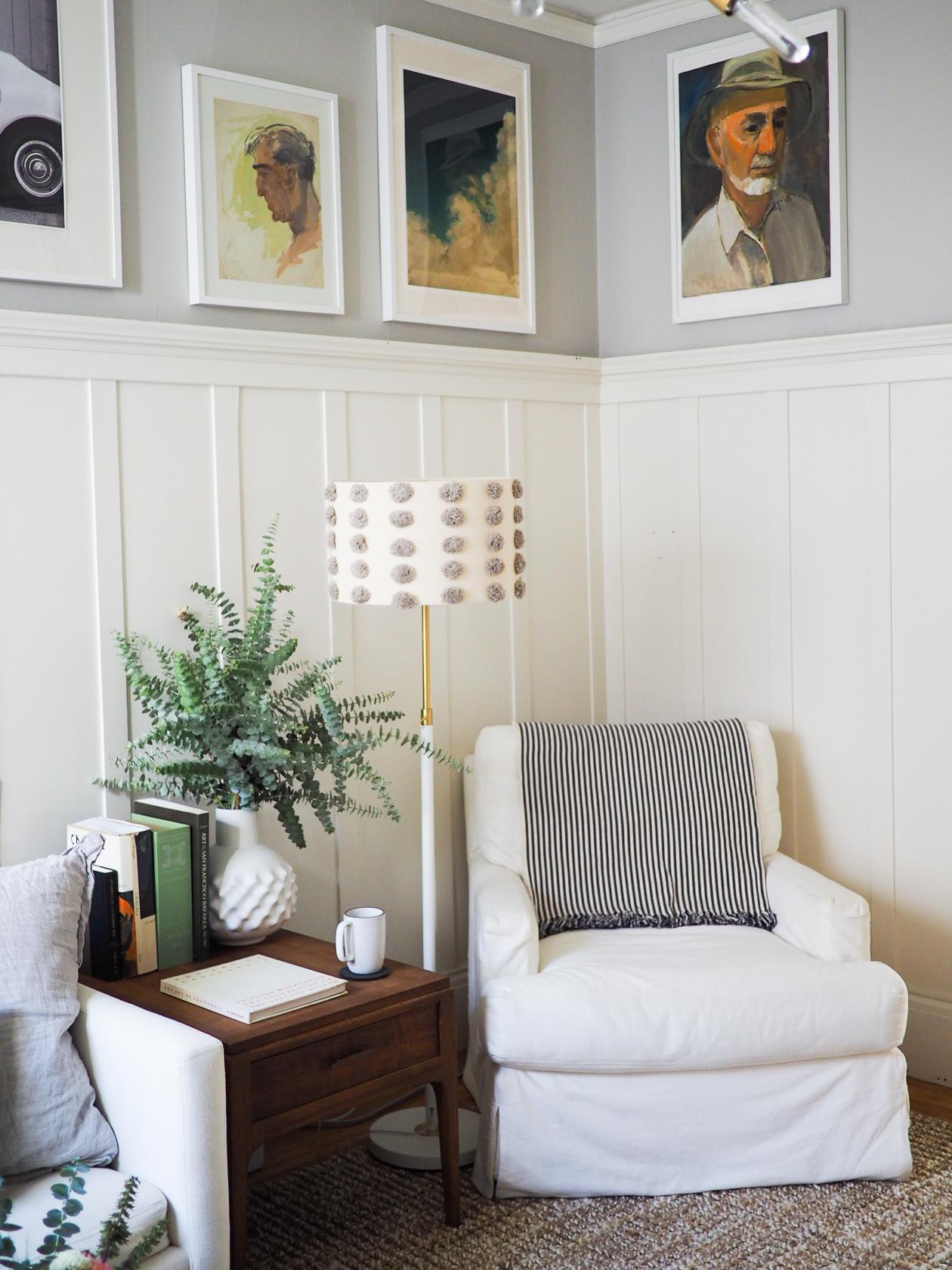 Side table: vintage via Craiglist. Coffee mug:  Heath . White vase: CB2. White standing lamp:  West Elm . Pom pom lampshade:  Anthropologie . Blue cloud print: by Kai Samuel Davis via  Etsy .