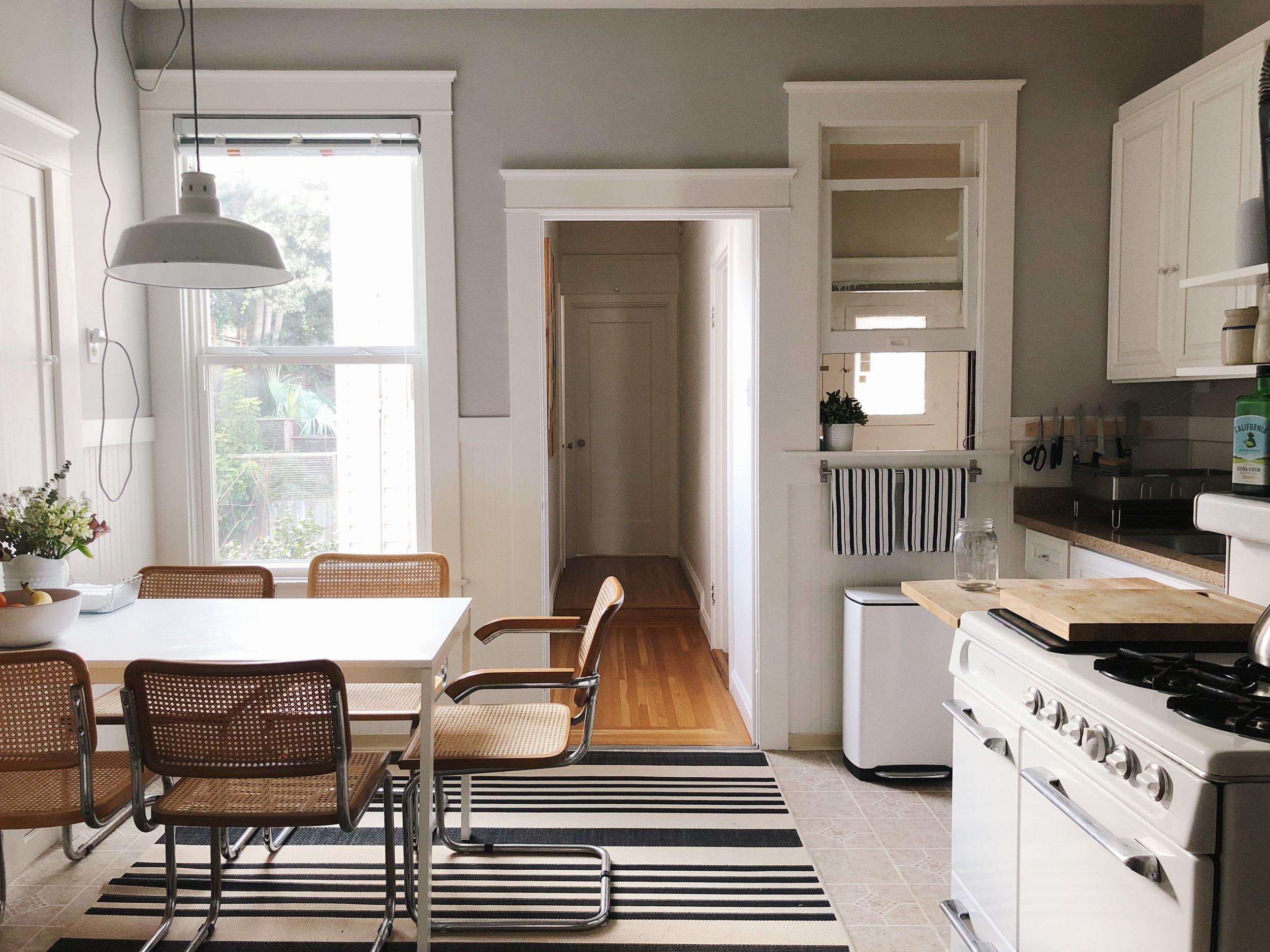 Table: Ikea. Chairs: Craigslist, similar via Amazon. Rug:  Amazon . Trash can:  Simple Human . Striped dish towels:  Wiliams Sonoma .