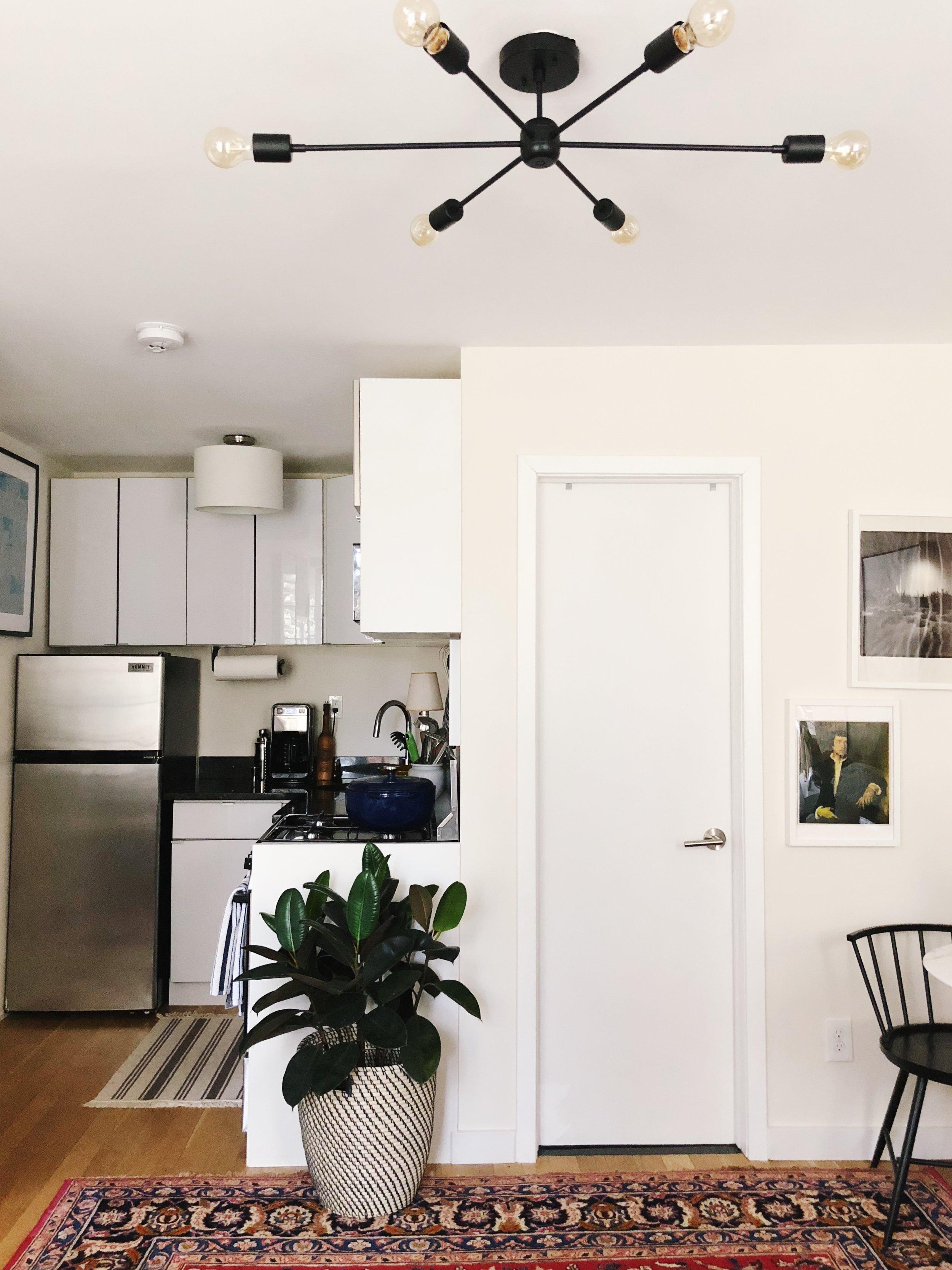Plant basket:  Ikea . Striped rug:  Ikea . Striped dish towels:  Williams Sonoma .