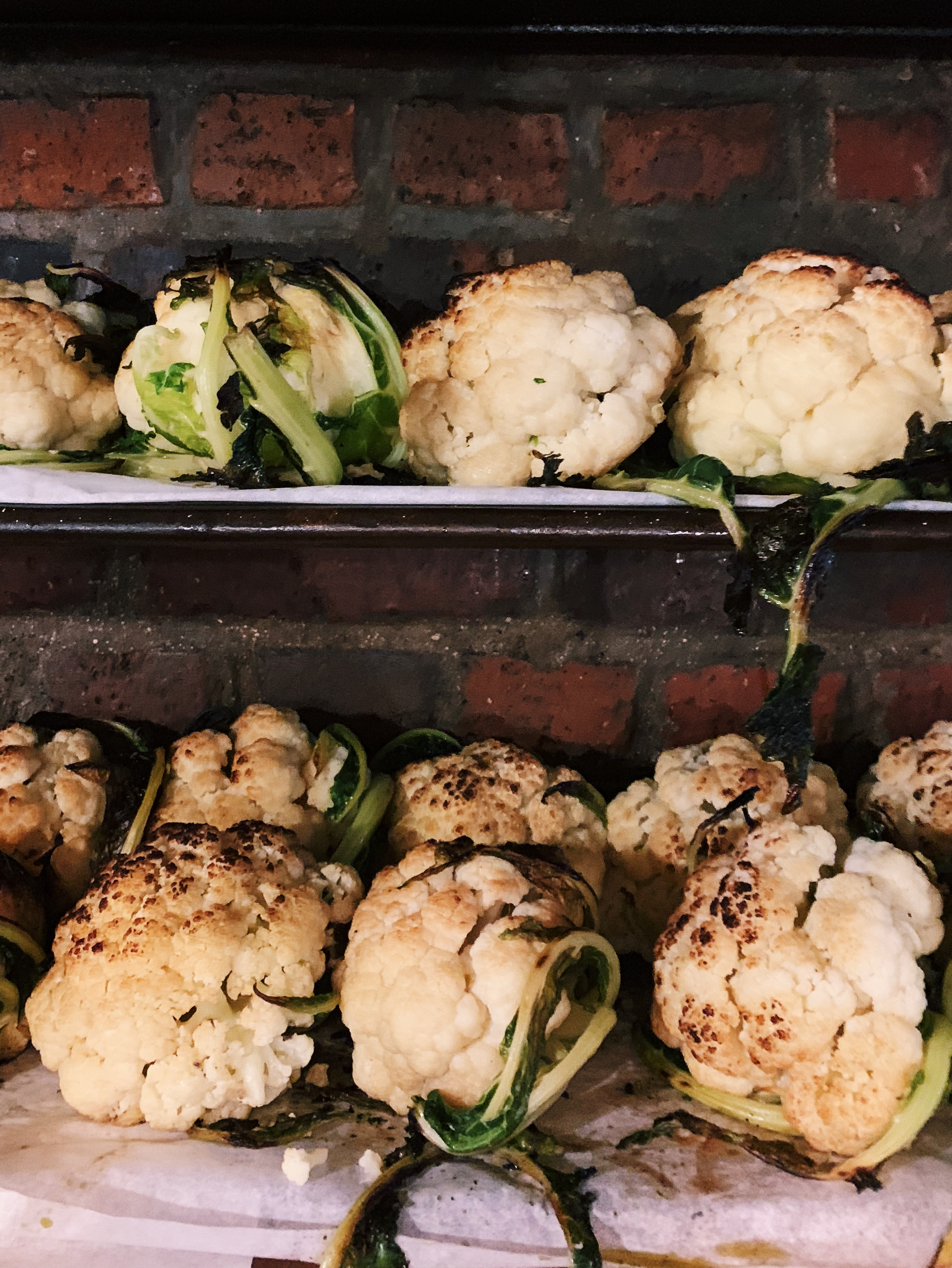 Entire roasted cauliflower heads at Miznon.