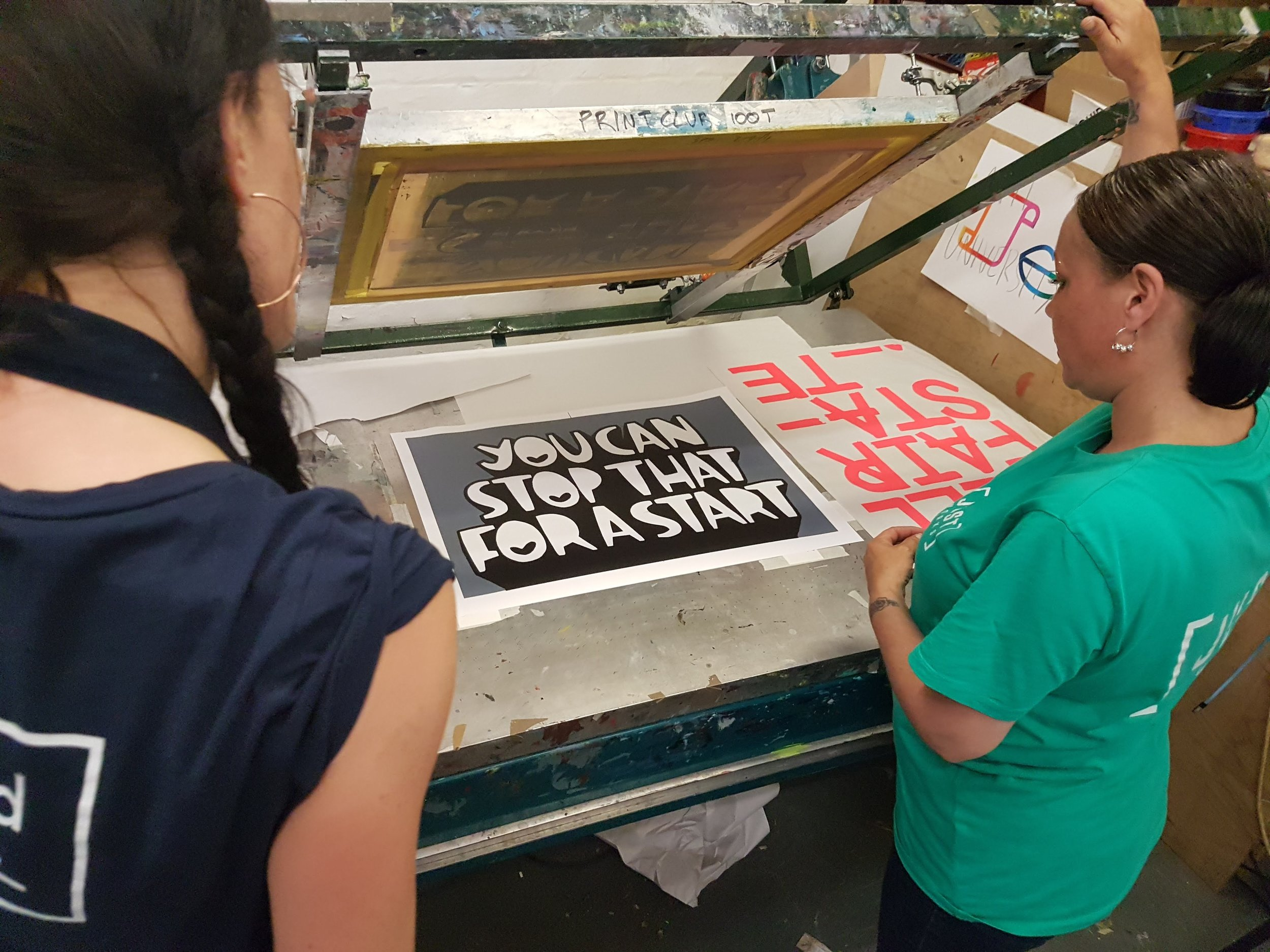 Amy & Andrea working on the print designed by Kid Acne.