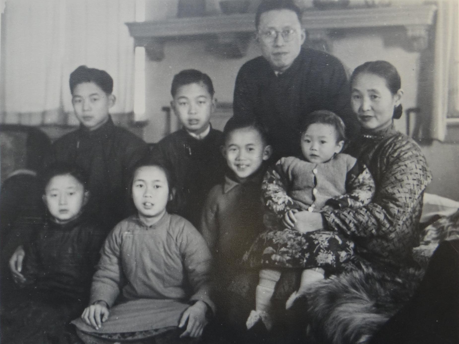 Ku family in Shanghai 1946.Back row left to right: #1 son Ku Wei-Lien, #2 son Ku Wei-Qing, Ku Yu-hsiu,  Mrs. Ku (Wang Wei-Zing ).Front row: #3 son Ku Wei-Hua (Walter), #1 daughter (3rd child) Ku Wei-Wen, #4 son Ku Wei-chung (John), #2 daughter Ku Wei-Ming (Anna). Not shown: #5 son Ku Wei-Kuo (Victor).  Courtesy Anna Ku Lau.