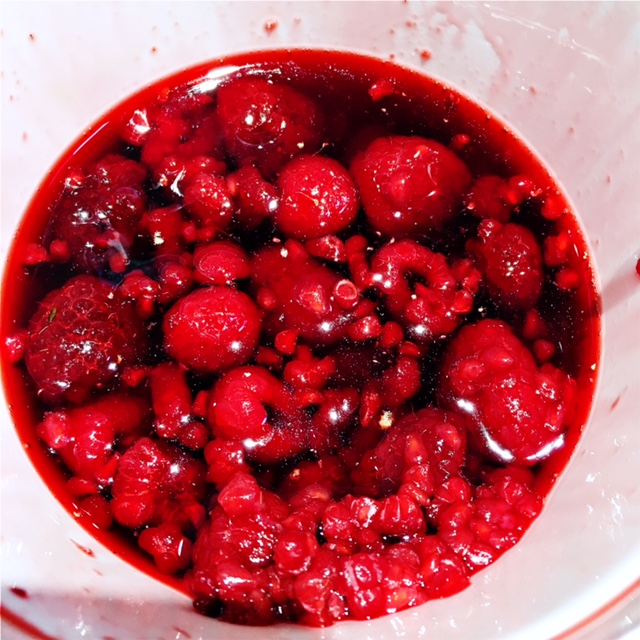 Raspberries in light syrup, thawed overnight in the fridge. You can find these in the frozen fruit aisle at the grocery store.