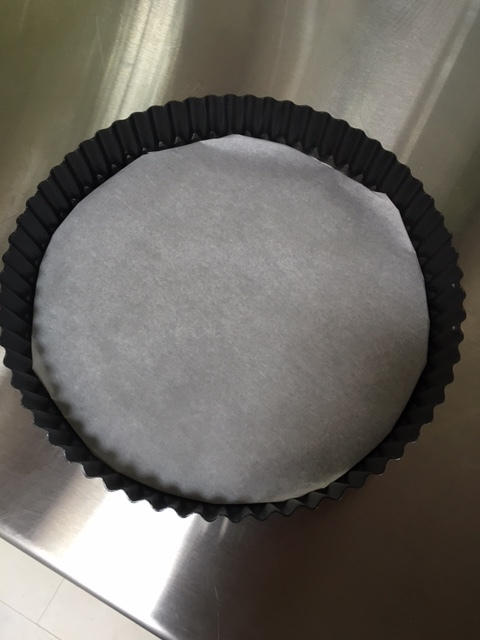 Wrap the bottom of your tart pan in parchment paper.