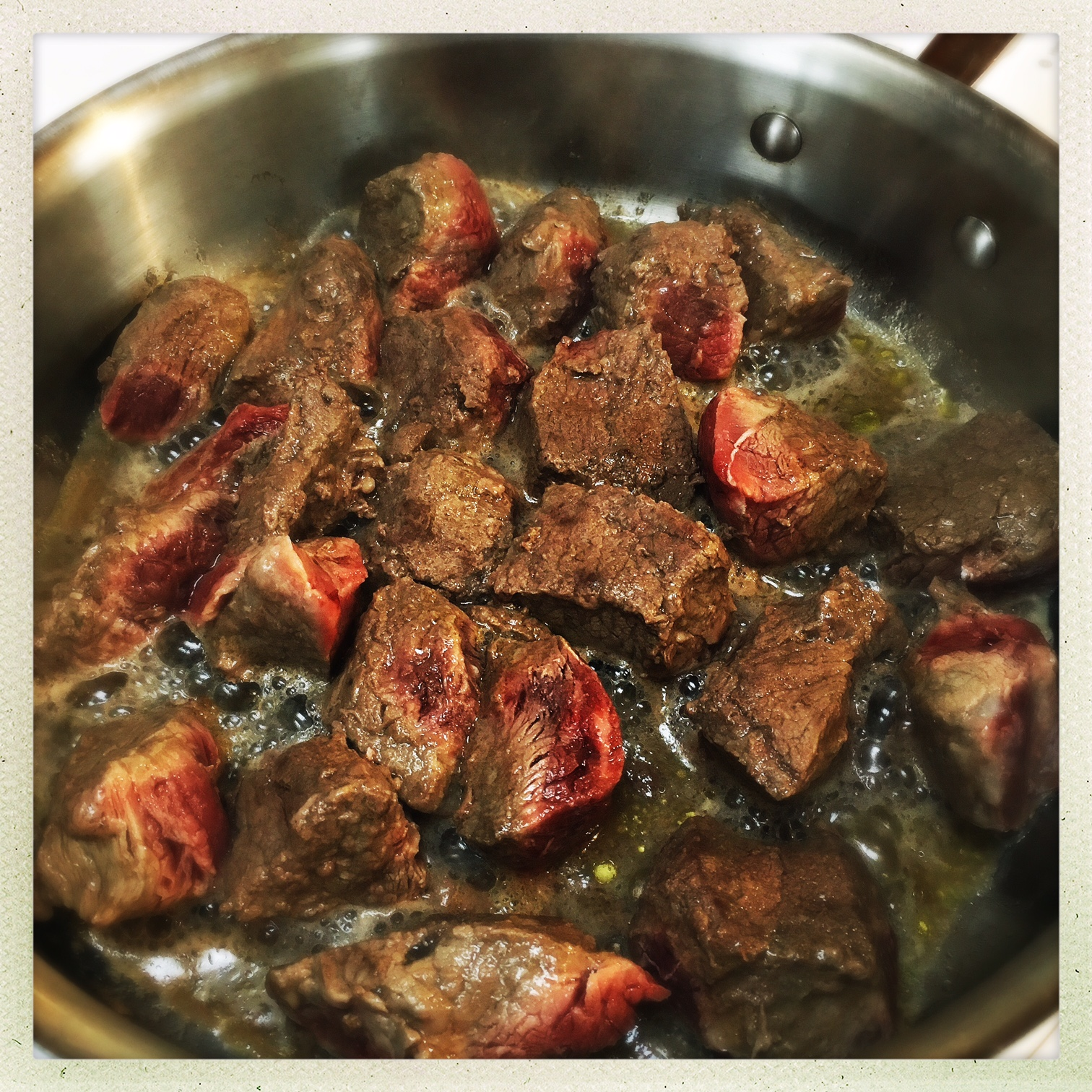 searing steak in pan.jpg