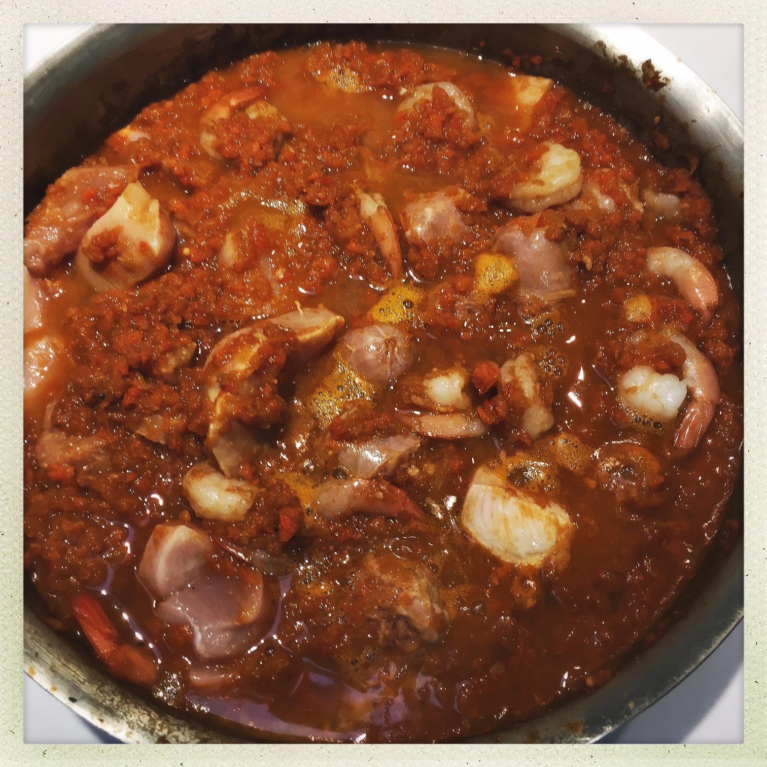 cook meat down in sauce.jpg