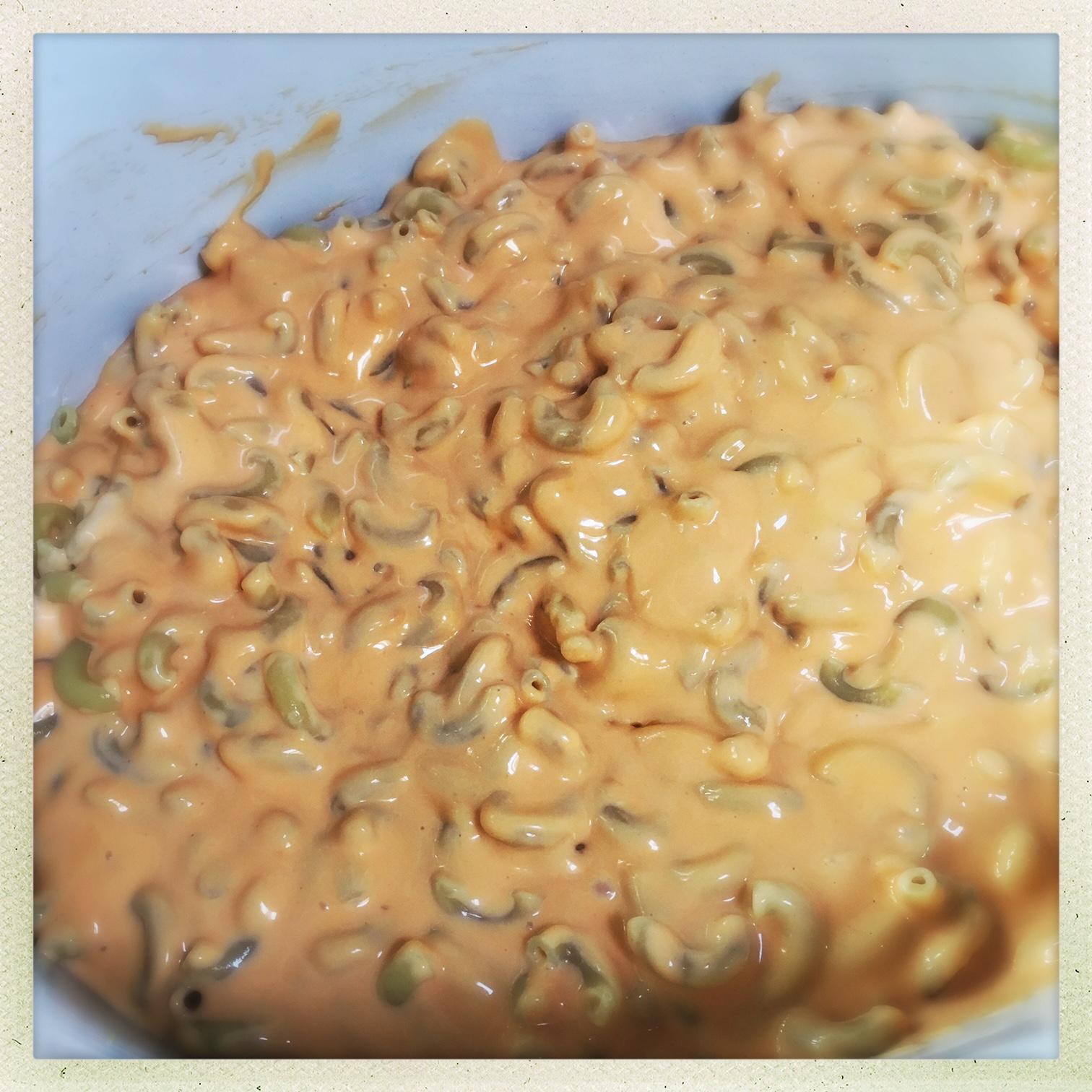 cheese sauce and pasta into crockpot.jpg