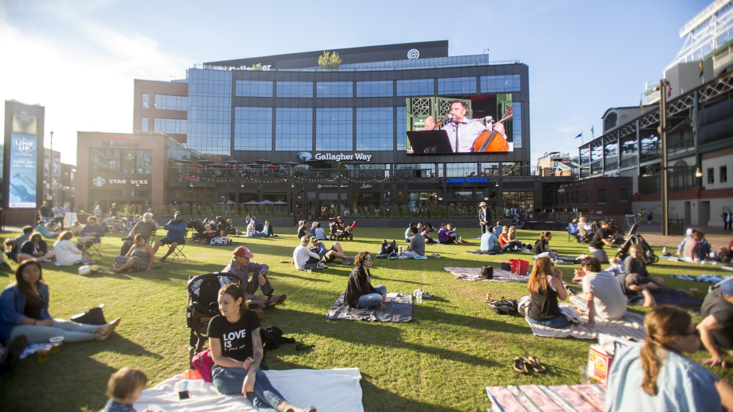 Gallagher Way - WRIGLEYVILLE'S NEW GATHERING PLACELocated in the heart of Wrigleyville, Gallagher Way offers a beautiful open-air destination for movies, concerts, farmers markets, community events and much more.