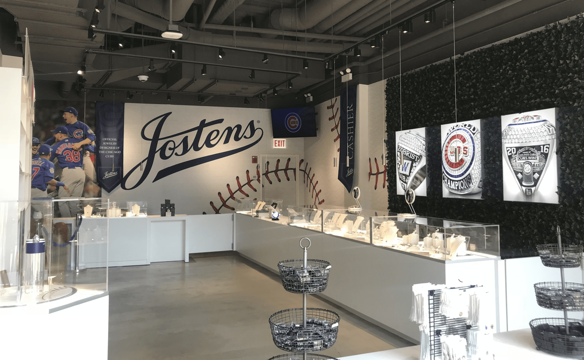 Josten's - Visit the Jostens Jewelry Store and take home a piece of Cubs history. The Josten's store at Gallagher Way features masterfully crafted collectibles that commemorate the Chicago Cubs' historic 2016 season.3641 N Clark StreetChicago, IL 60613877-244-2827