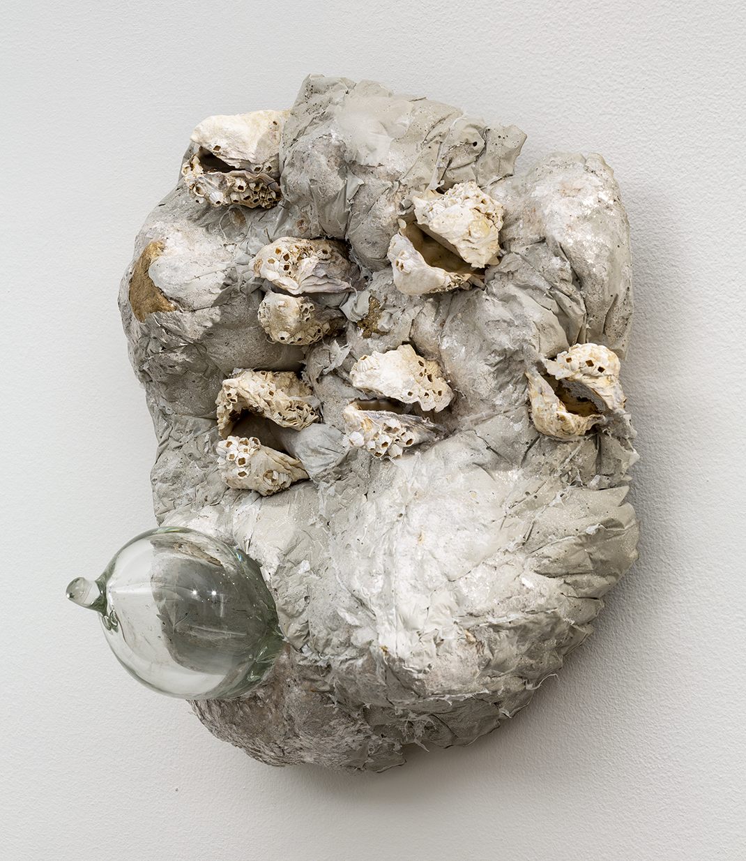 Alta Buden,  Umbos , 2019, Rockite, oyster shells, mica, hand blown glass, 13 x11 x 6 inches
