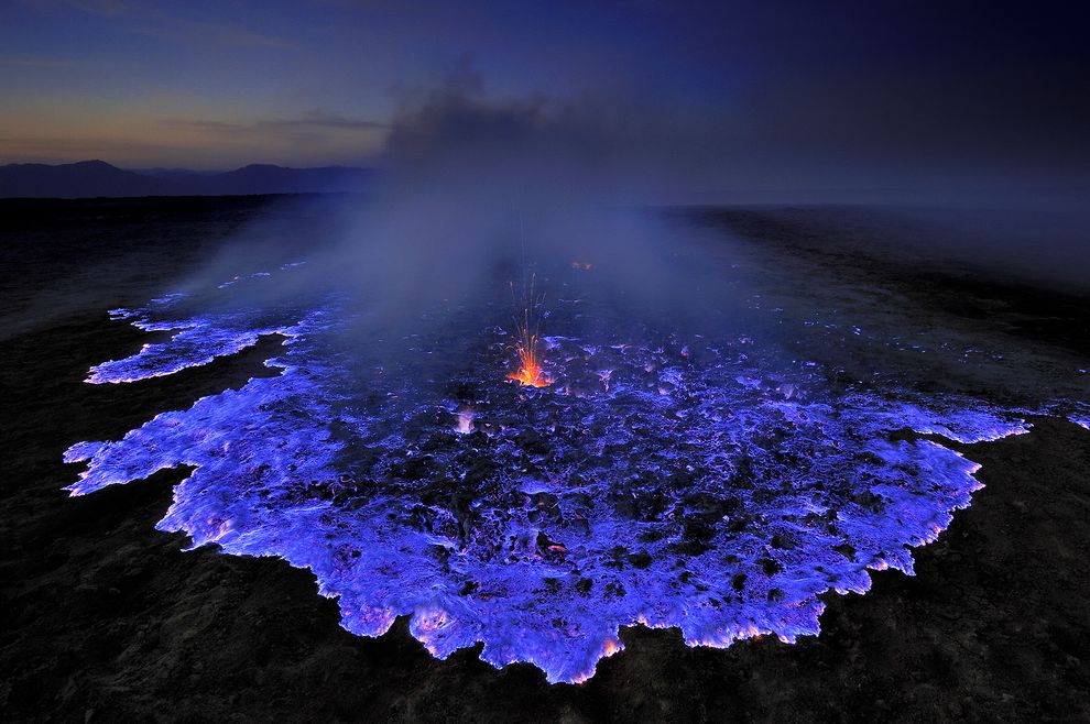 congenitaldisease :     This volcano in Indonesia produces  blue lava.  This is caused by the combustion of sulphuric gasses at very high temperatures.