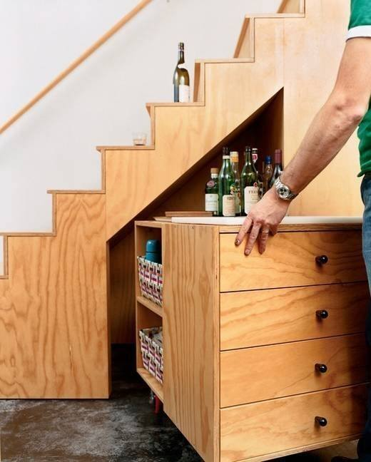 TinyHouseCottages under stairs storage.jpg