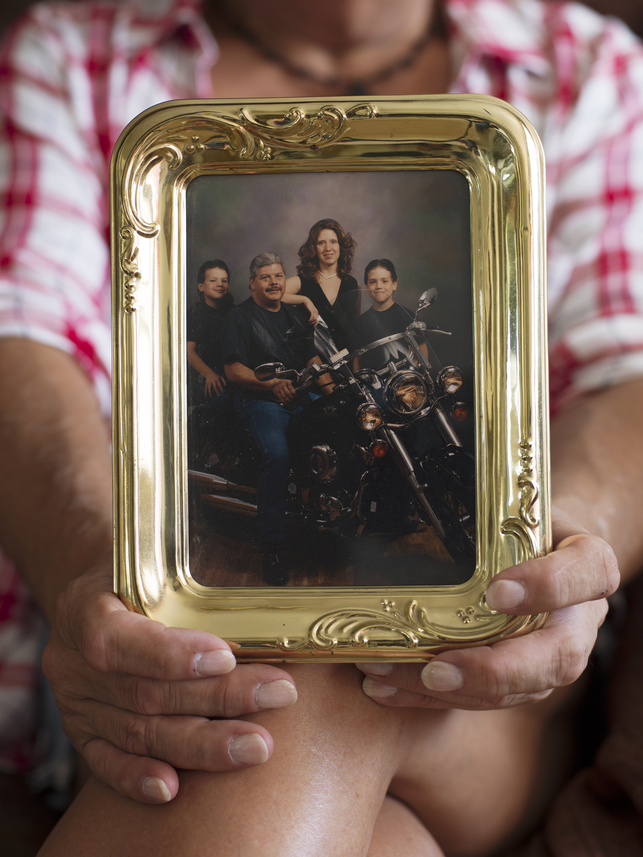 Bobbie holding a family photo from before her transition, Hanford, CA, 2016