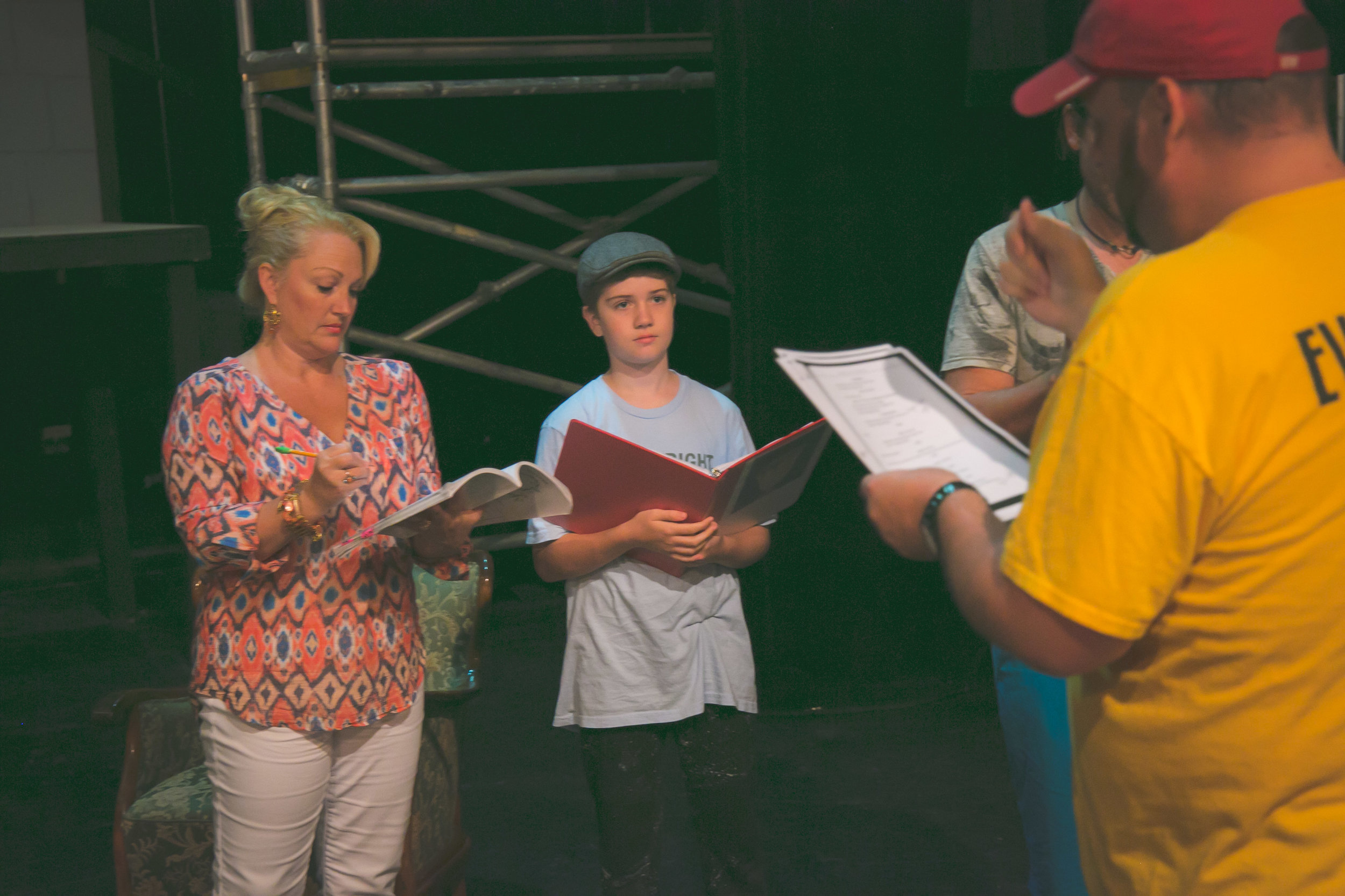 Director David Nanny goes over blocking notes with Corina and Bruce.