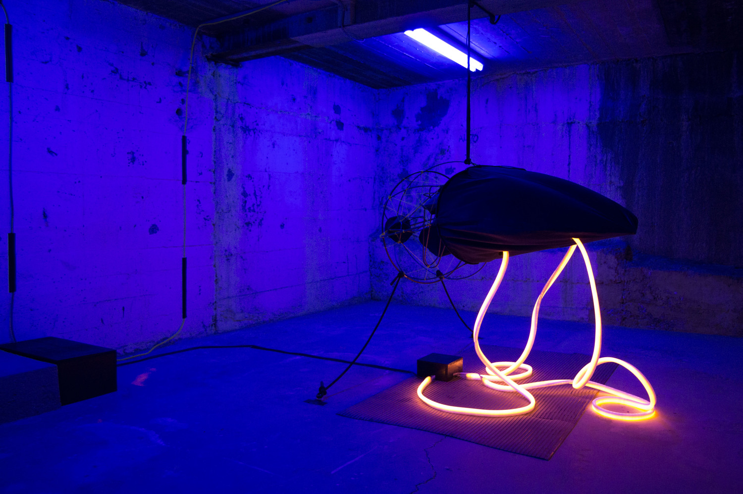 Pamela Leszczynski, Big Mama , Installation work.Metal, wood, fluorescent lighting fixtures, string (yellow and black), neon rope lights, velveteen, Plexi-glass, Arduino and electronic components, air pump, digital metronomes, tubing, clamps, plastic bag.Dimensions of  Big Mama : 5' x 2' x 2'