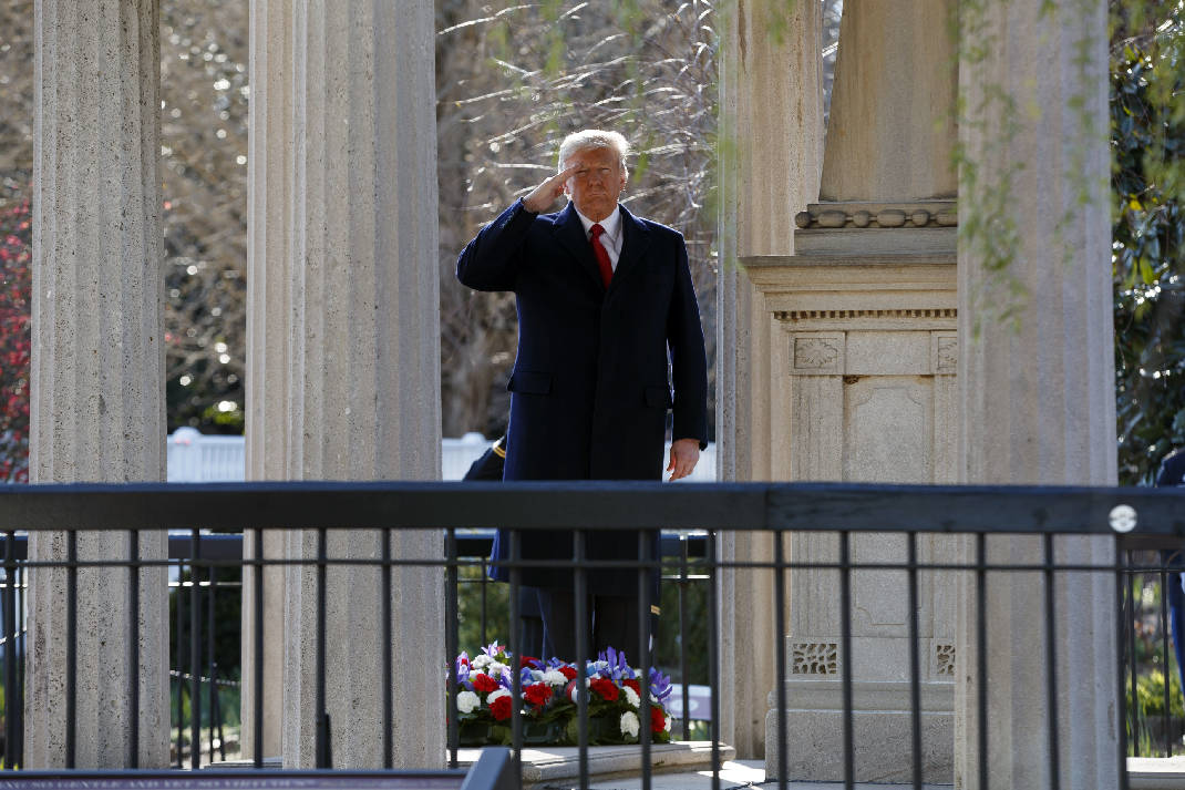 President Trump salutes after placing a wreath at Jackson's tomb.